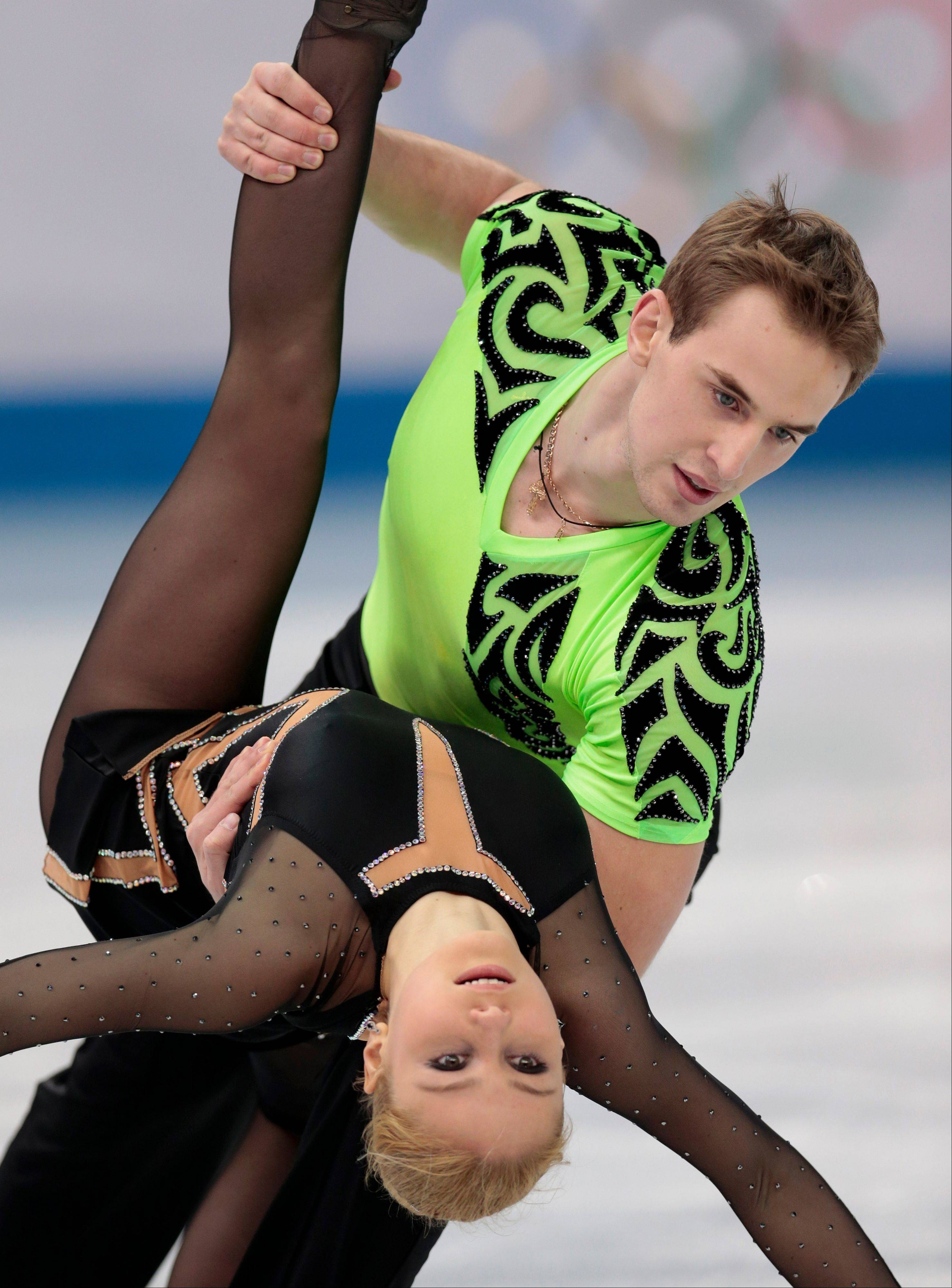 Julia Lavrentieva and Yuri Rudyk of Ukraine compete in the team pairs short program figure skating competition at the Iceberg Skating Palace during the 2014 Winter Olympics.
