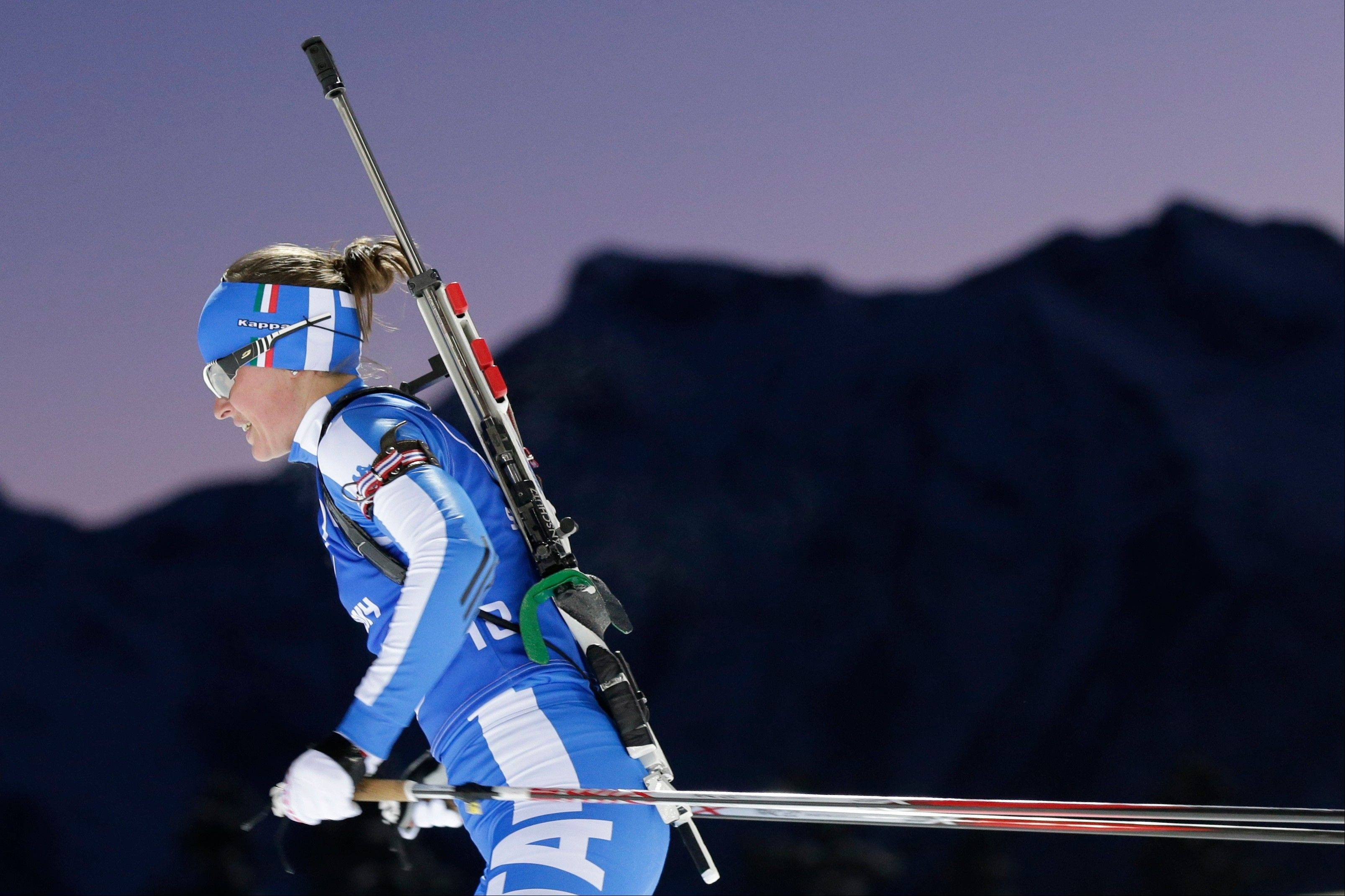 Italy's Karin Oberhofer skis during a biathlon training session at the 2014 Winter Olympics, Thursday, Feb. 6, 2014, in Krasnaya Polyana, Russia.