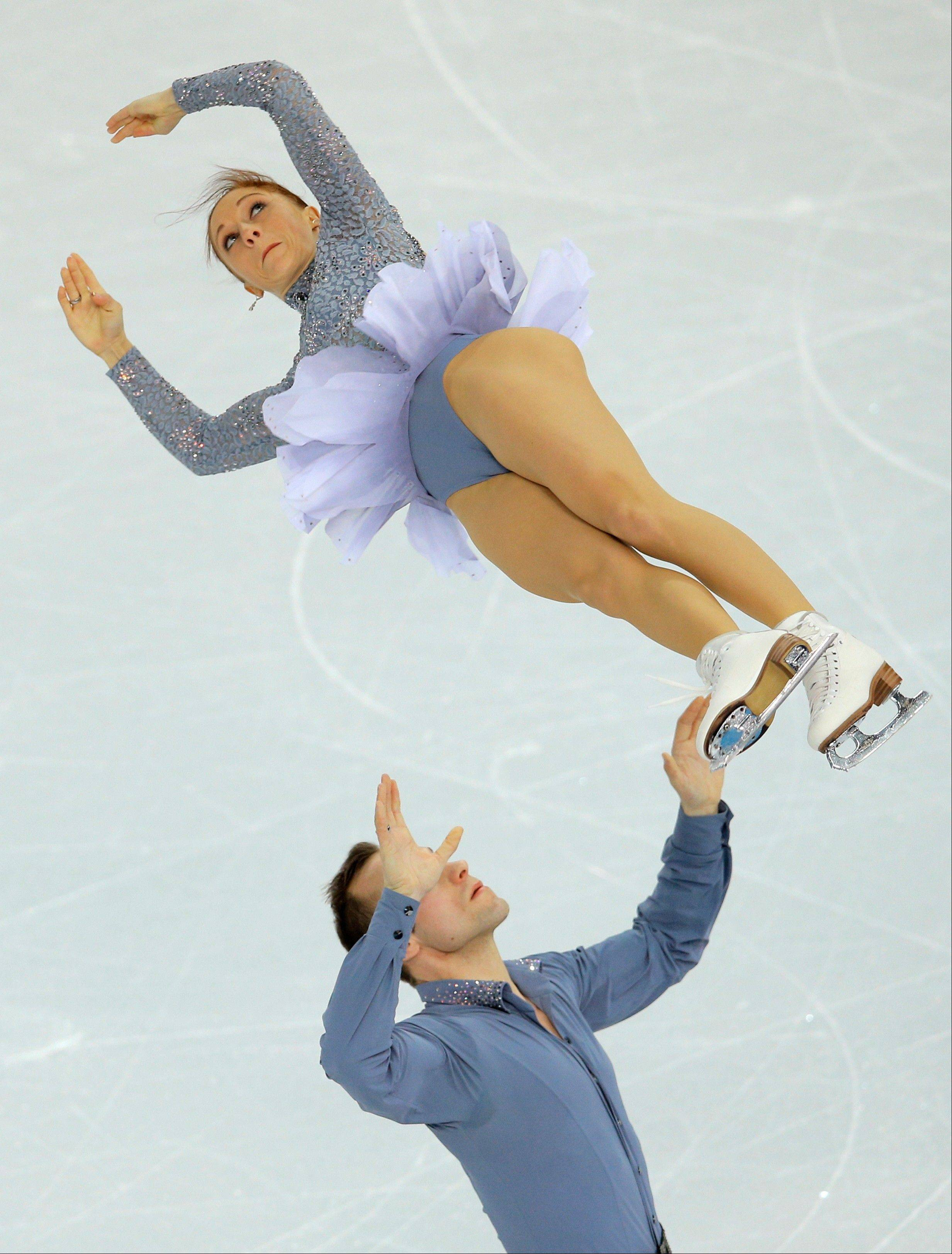 Maylin Wende and Daniel Wende of Germany compete in the team pairs short program figure skating competition at the Iceberg Skating Palace during the 2014 Winter Olympics.