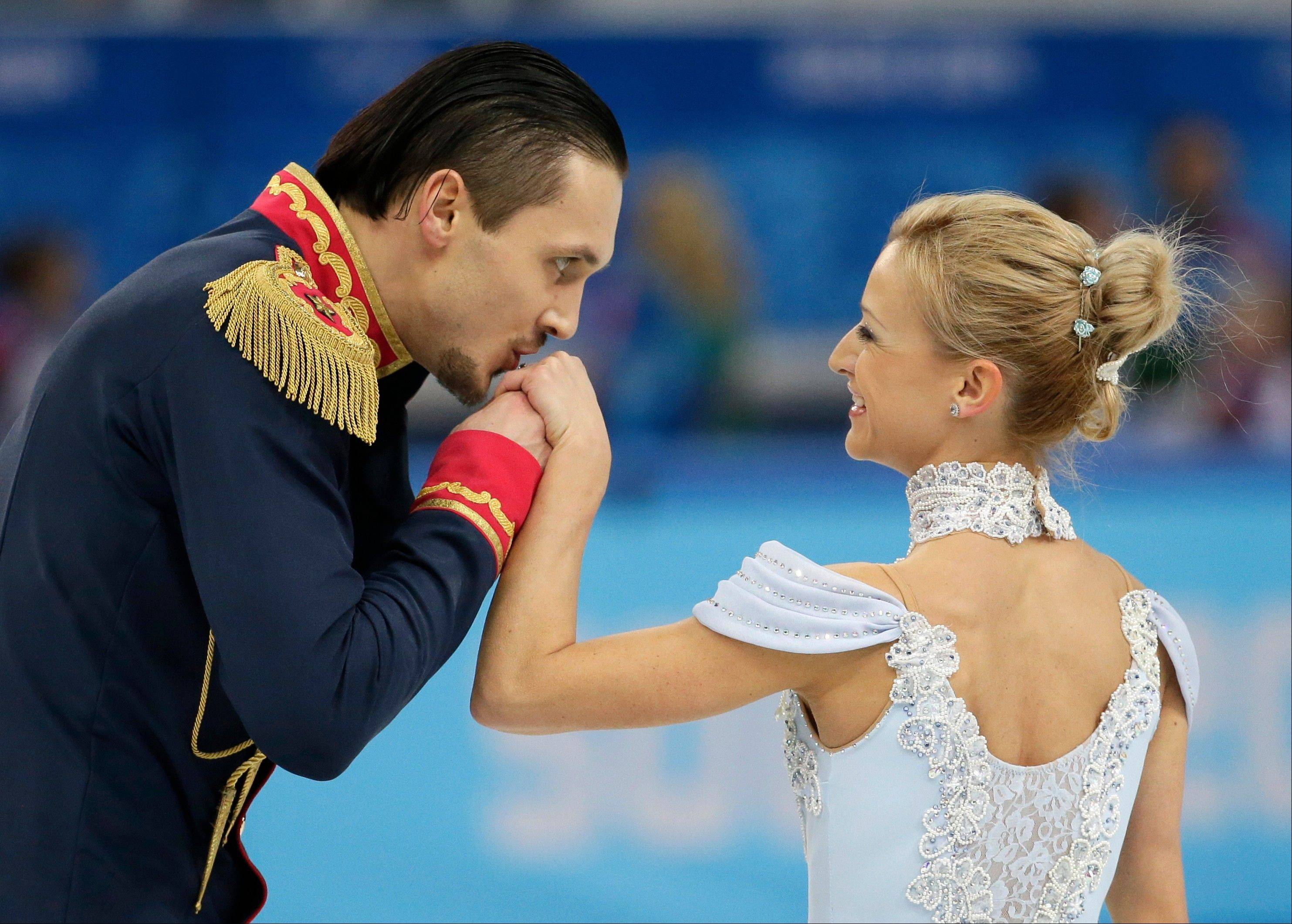 Russia's Maxim Trankov kisses Tatiana Volosozhar's hand after competing in the team pairs short program figure skating competition at the Iceberg Skating Palace.