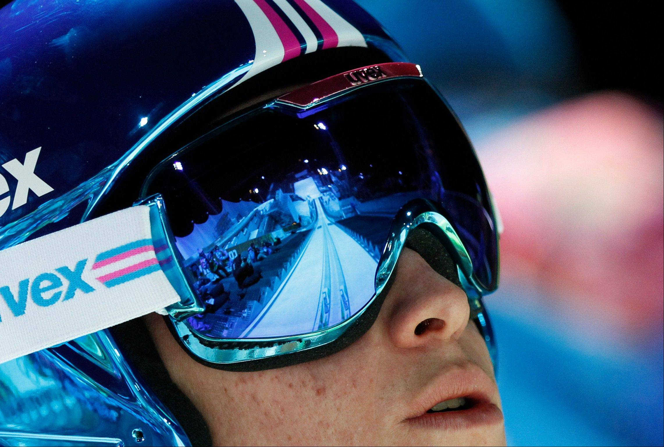 Slovenia's Peter Prevc prepares for an attempt in training for the men's normal hill ski jumping at the 2014 Winter Olympics, Thursday, Feb. 6, 2014, in Krasnaya Polyana, Russia.