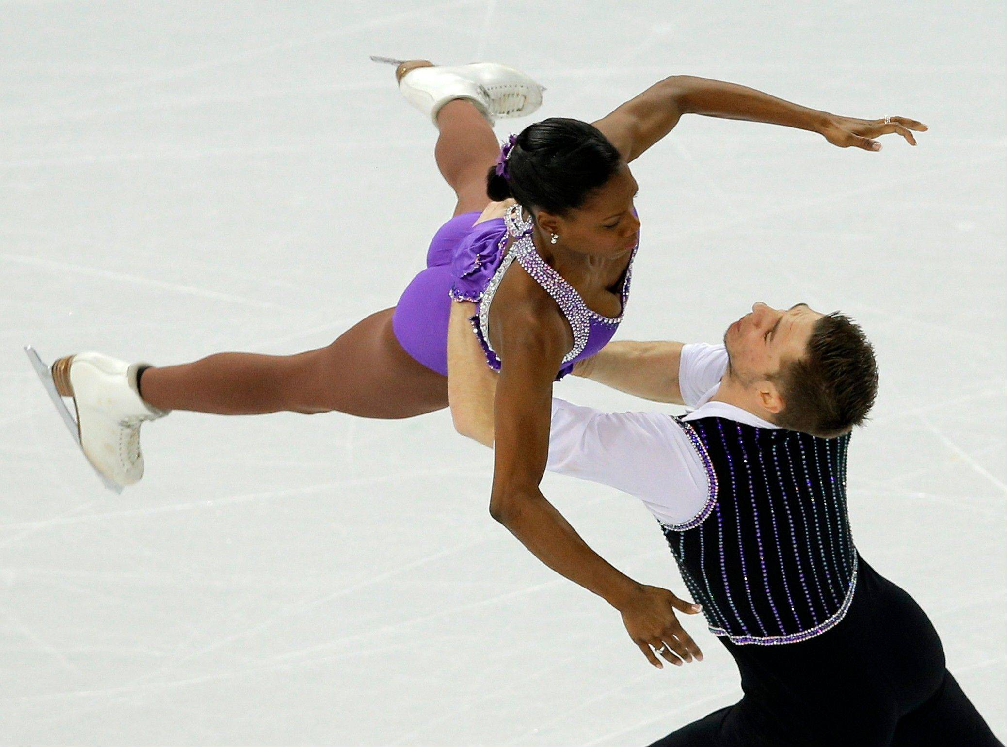 Vanessa James and Morgan Cipres of France compete in the team pairs short program figure skating competition at the Iceberg Skating Palace during the 2014 Winter Olympics, Thursday, Feb. 6, 2014, in Sochi, Russia.
