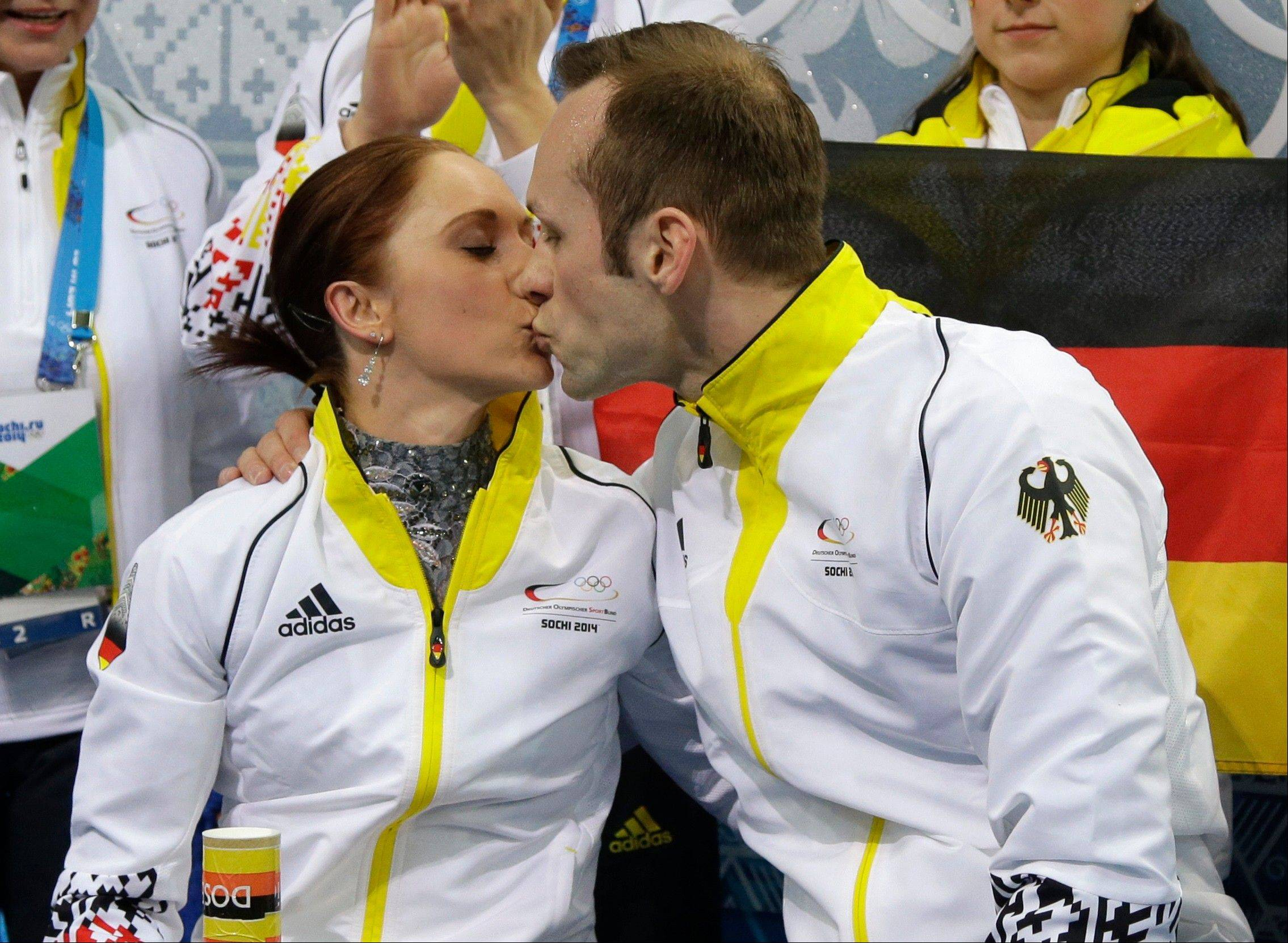 Maylin Wende and Daniel Wende of Germany kiss as they wait for their results after competing in the team pairs short program figure skating competition at the Iceberg Skating Palace during the 2014 Winter Olympics.