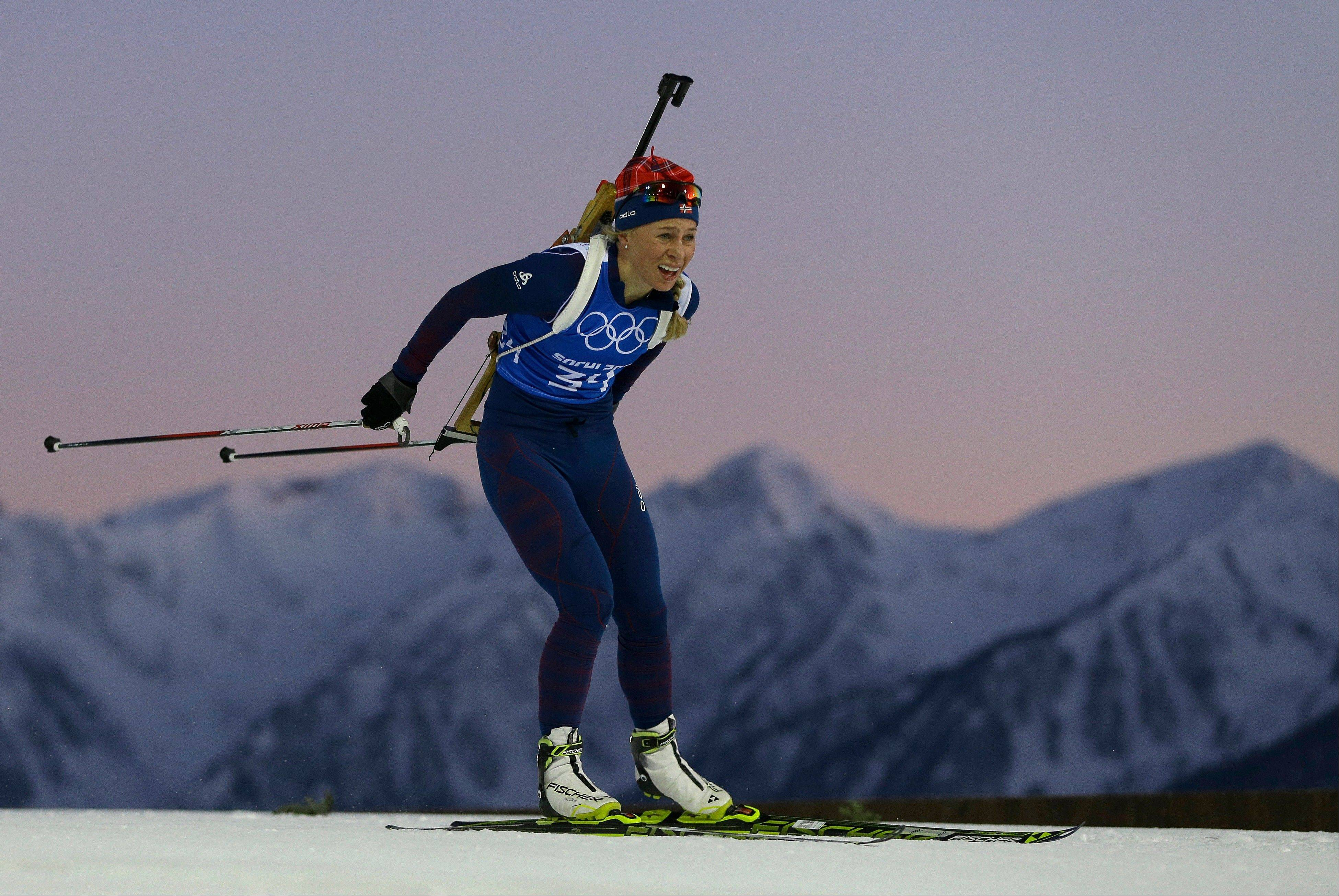 Tiril Eckhoff of Norway skis past mountain tops during a biathlon training session at the 2014 Winter Olympics, Thursday, Feb. 6, 2014, in Krasnaya Polyana, Russia.