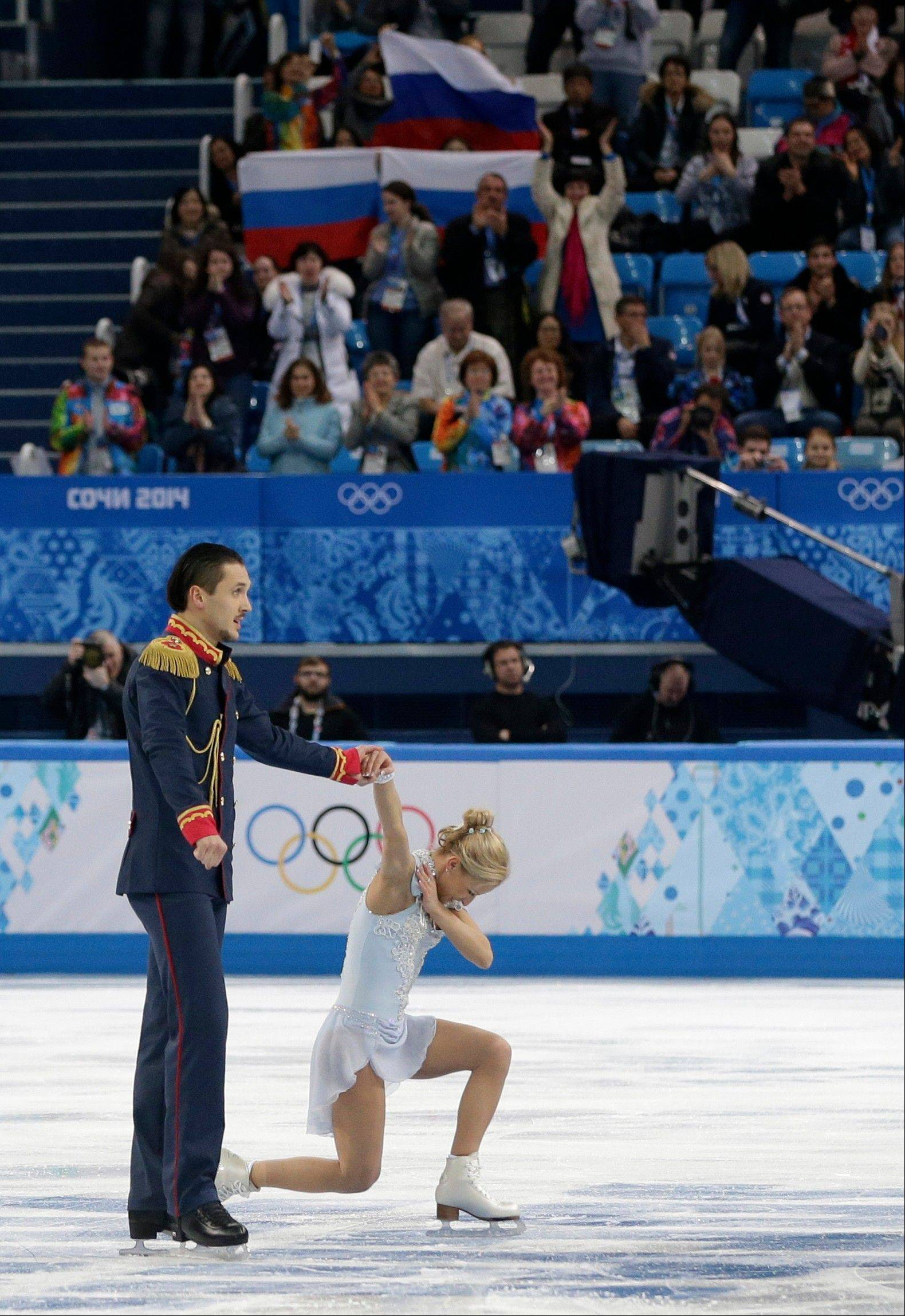 Tatiana Volosozhar and Maxim Trankov of Russia finish their routine in the team pairs short program figure skating competition at the Iceberg Skating Palace during the 2014 Winter Olympics.