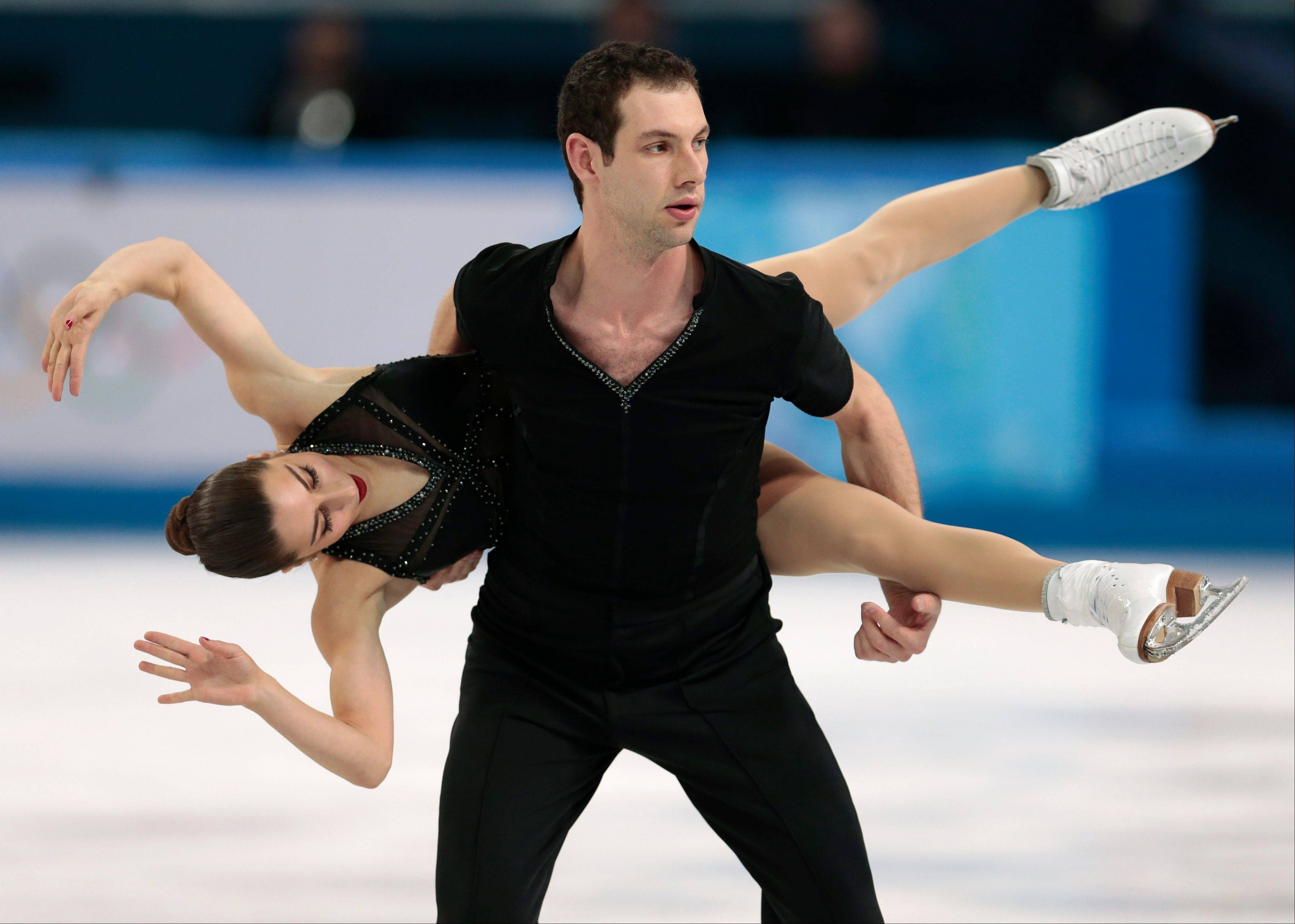 Marissa Castelli and Simon Shnapir of The United States compete in the team pairs short program igure skating competition at the Iceberg Skating Palace during the 2014 Winter Olympics.