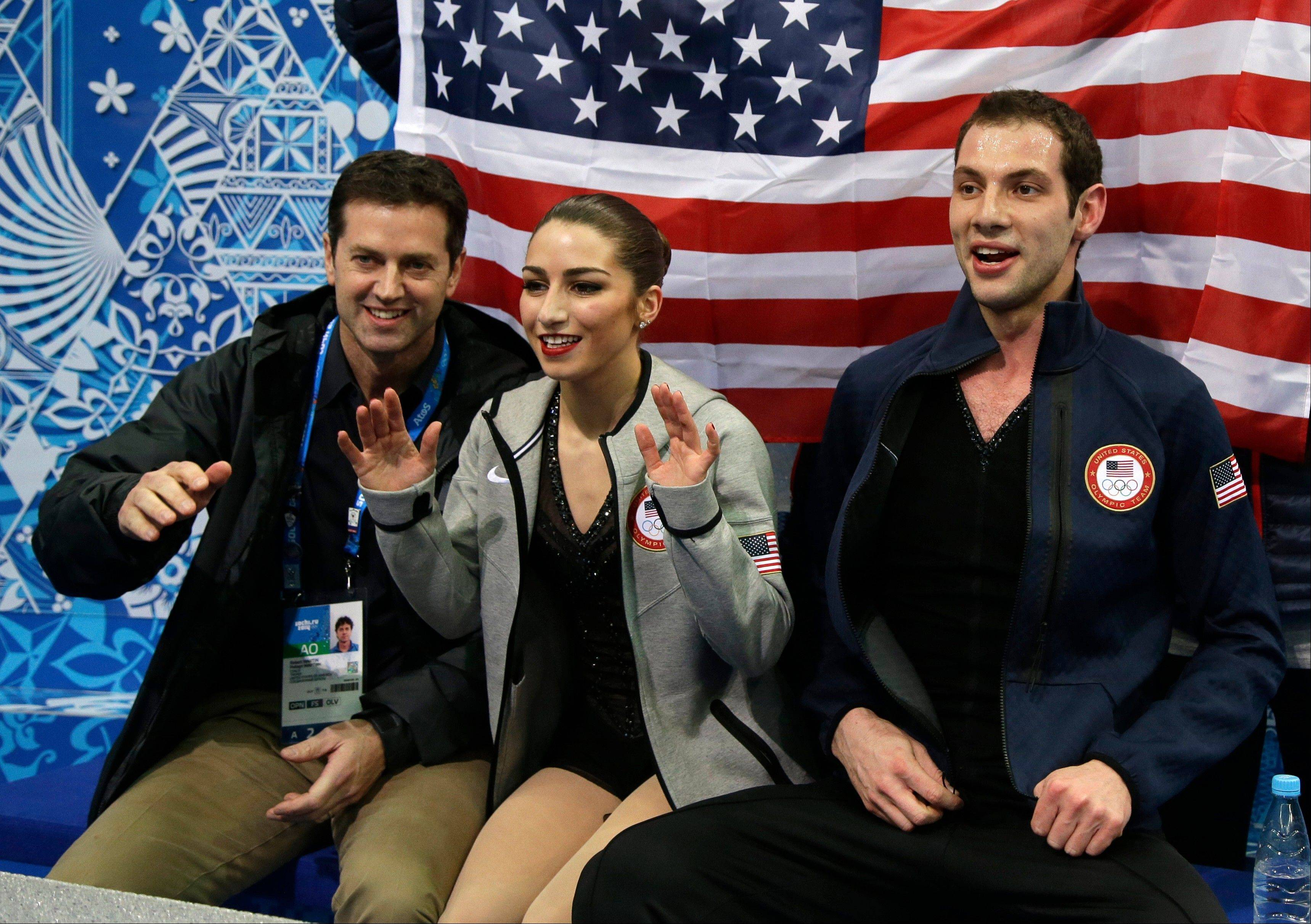 Marissa Castelli and Simon Shnapir of the United States wait for their results following the the team pairs short program figure skating competition at the Iceberg Skating Palace during the 2014 Winter Olympics.