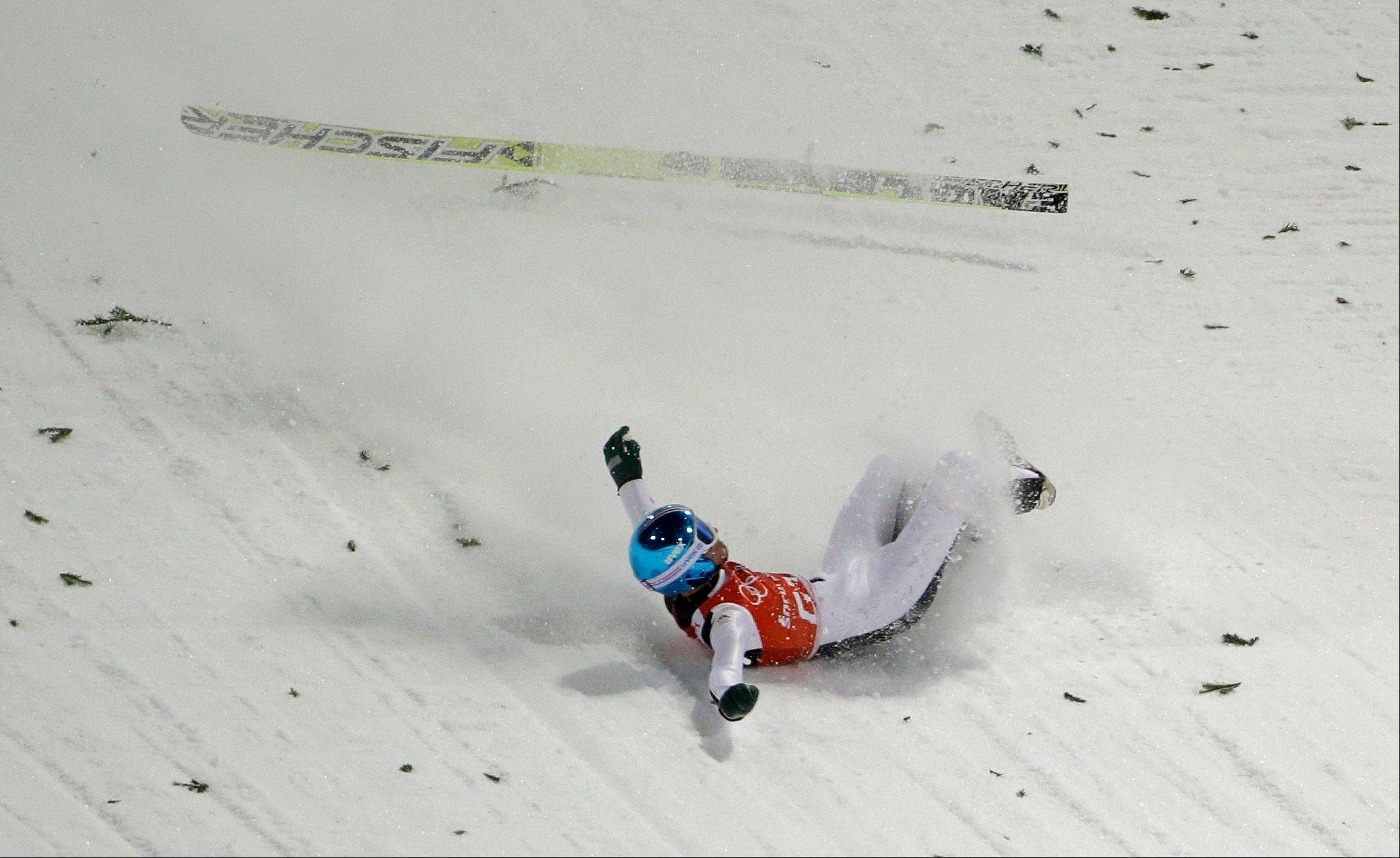 Slovenia's Robert Kranjec falls after a training jump from the normal hill of the men's ski jumping at the 2014 Winter Olympics, Thursday, Feb. 6, 2014, in Krasnaya Polyana, Russia.