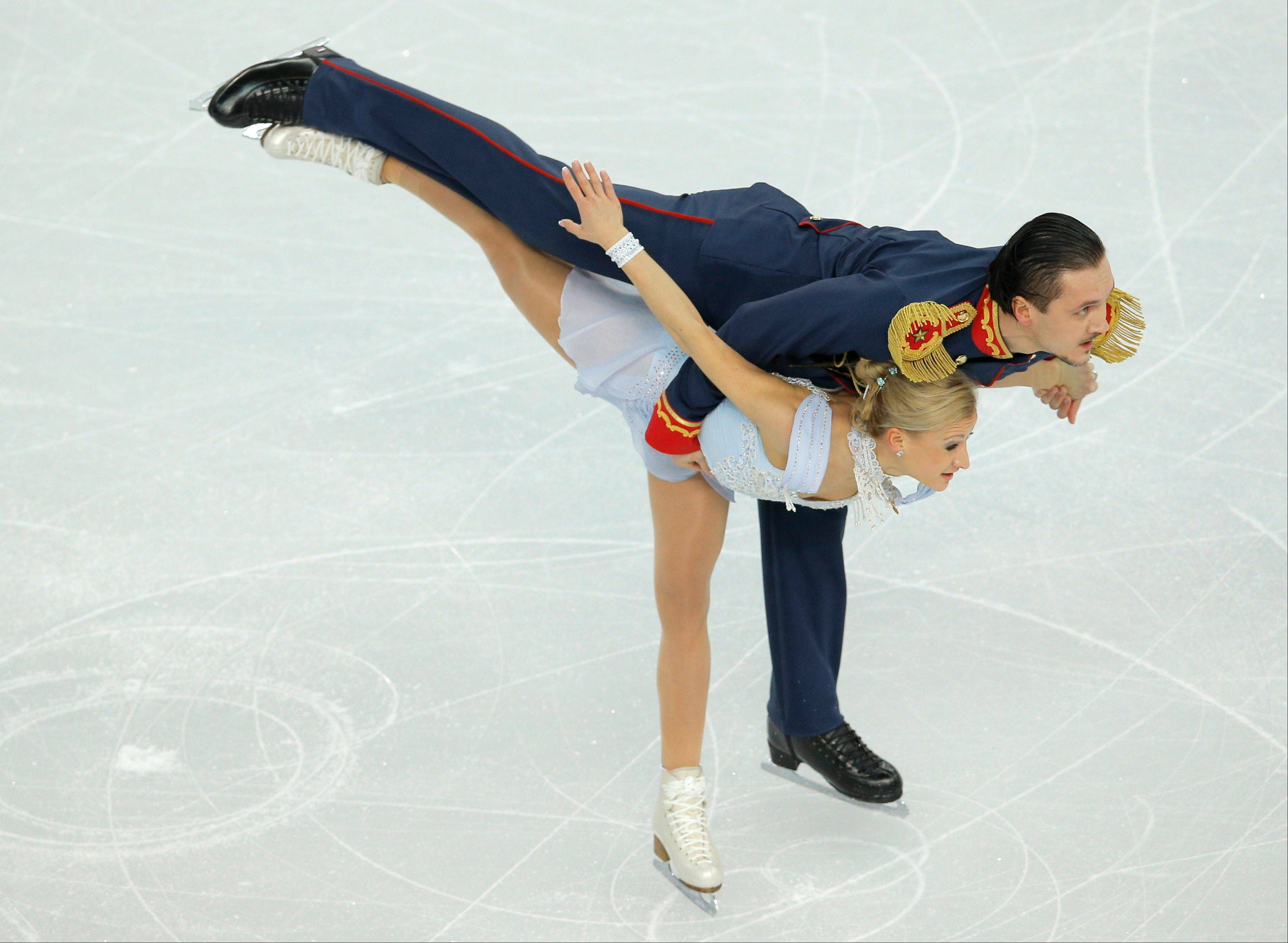 Tatiana Volosozhar and Maxim Trankov of Russia compete in the team pairs short program figure skating competition at the Iceberg Skating Palace during the 2014 Winter Olympics, Thursday, Feb. 6, 2014, in Sochi, Russia.