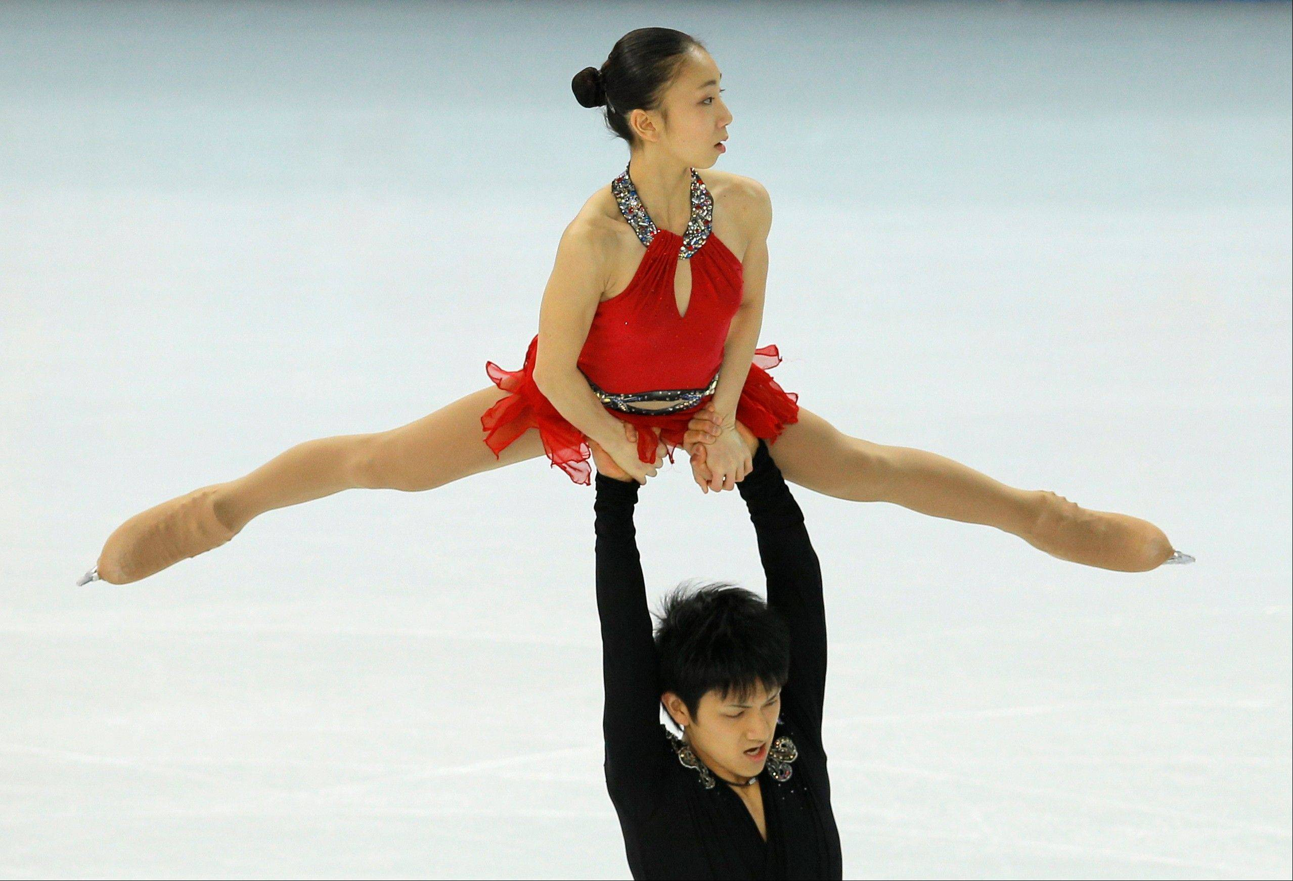 Narumi Takahashi and Ryuichi Kihara of Japan compete in the team pairs short program figure skating competition at the Iceberg Skating Palace during the 2014 Winter Olympics, Thursday, Feb. 6, 2014, in Sochi, Russia.