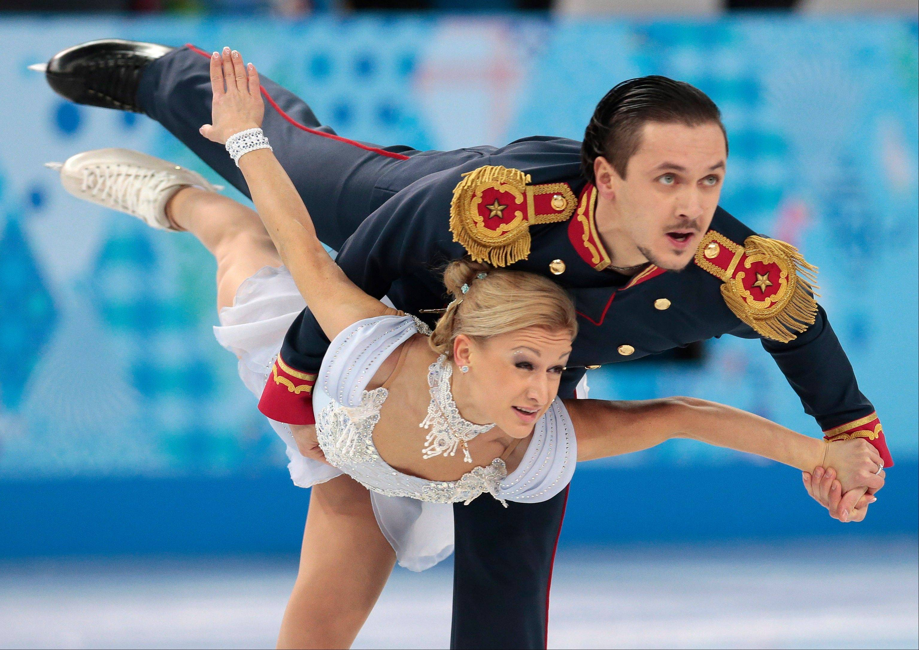 Tatiana Volosozhar and Maxim Trankov of Russia compete in the team pairs short program figure skating competition at the Iceberg Skating Palace during the 2014 Winter Olympics.