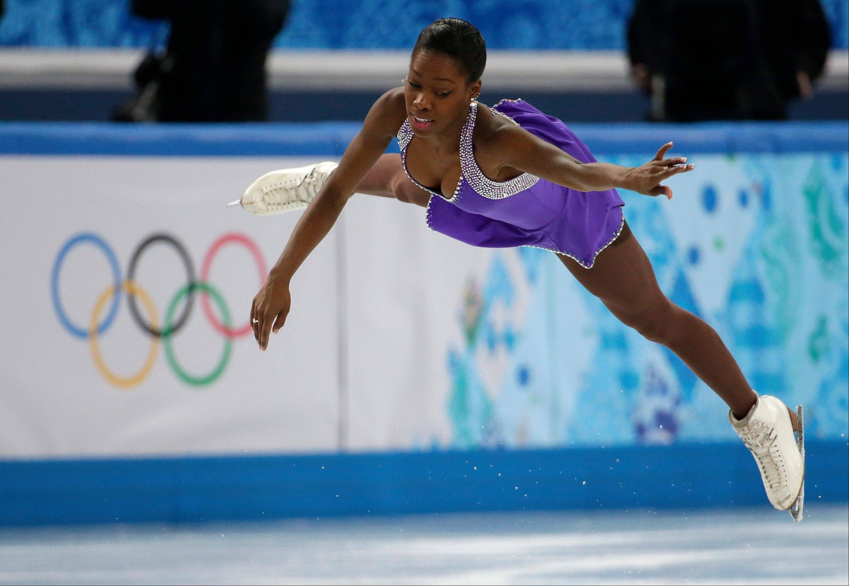 Vanessa James compete in the team pairs short program figure skating competition with Morgan Cipres of France at the Iceberg Skating Palace during the 2014 Winter Olympics.