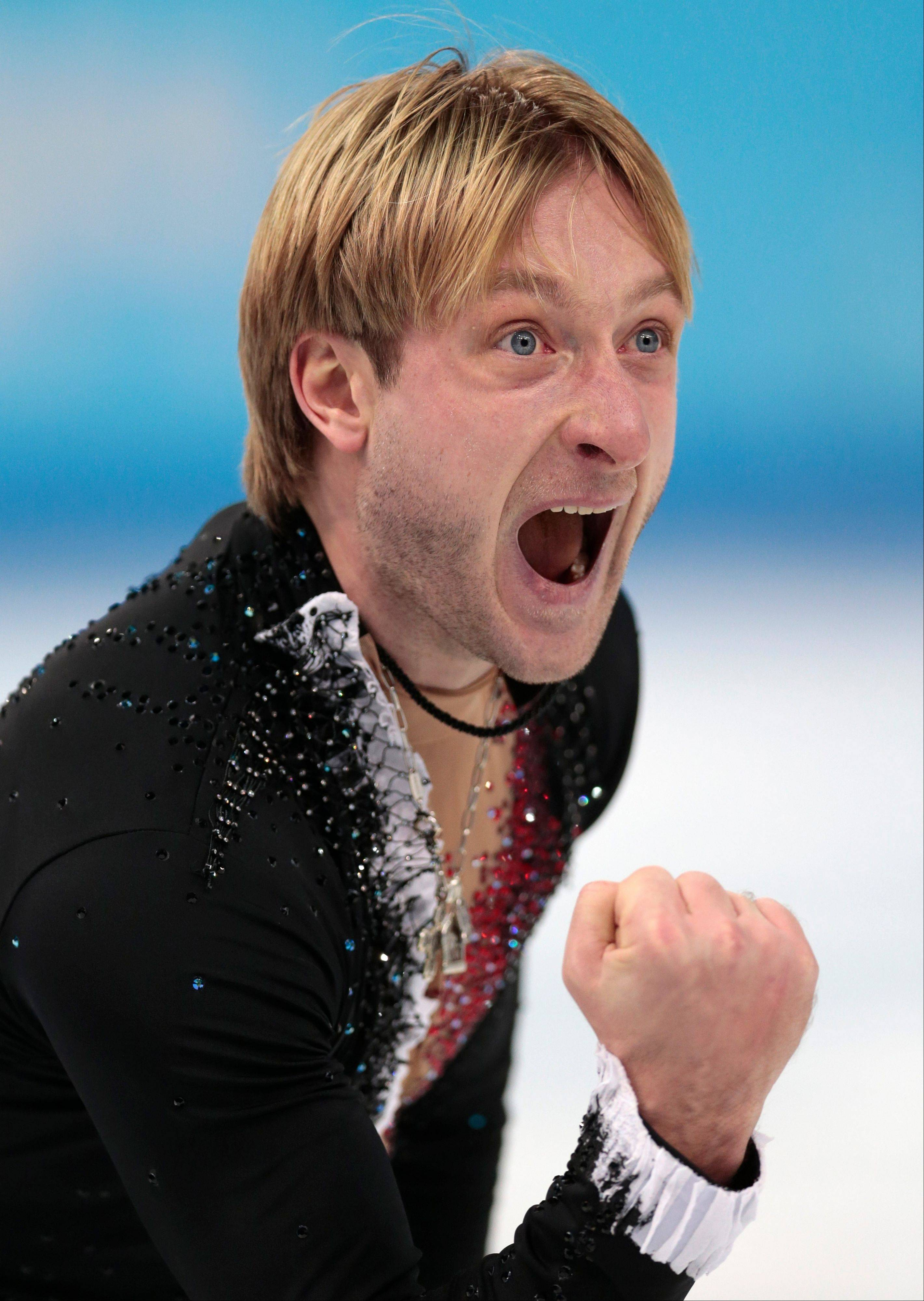 Evgeny Plyushchenko of Russia celebrates after competing in the men's team short program figure skating competition at the Iceberg Skating Palace during the 2014 Winter Olympics.