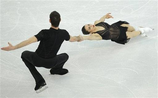 Marissa Castelli and Simon Shnapir of the United States compete in the team pairs short program figure skating competition at the Iceberg Skating Palace during the 2014 Winter Olympics, Thursday.