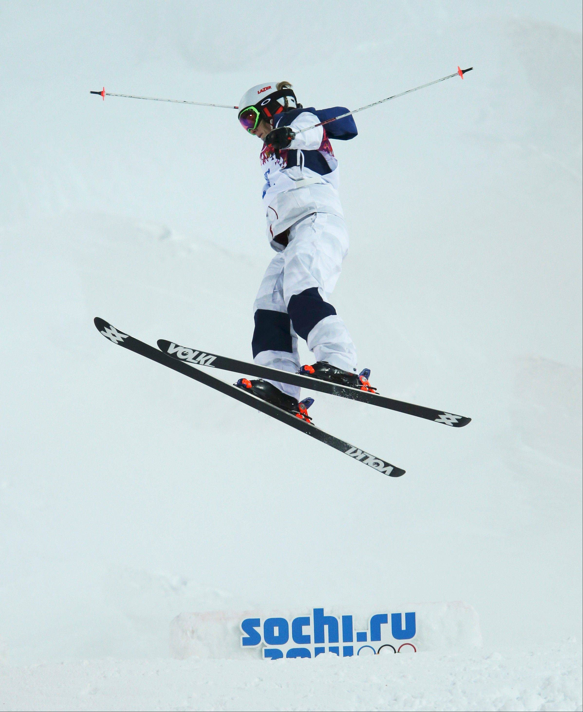 United States' Hannah Kearney jumps during qualifying in the women's moguls at the Rosa Kutor Exreme Park ahead of the 2014 Winter Olympics, Thursday, Feb. 6, 2014, in Krasnaya Polyana, Russia.