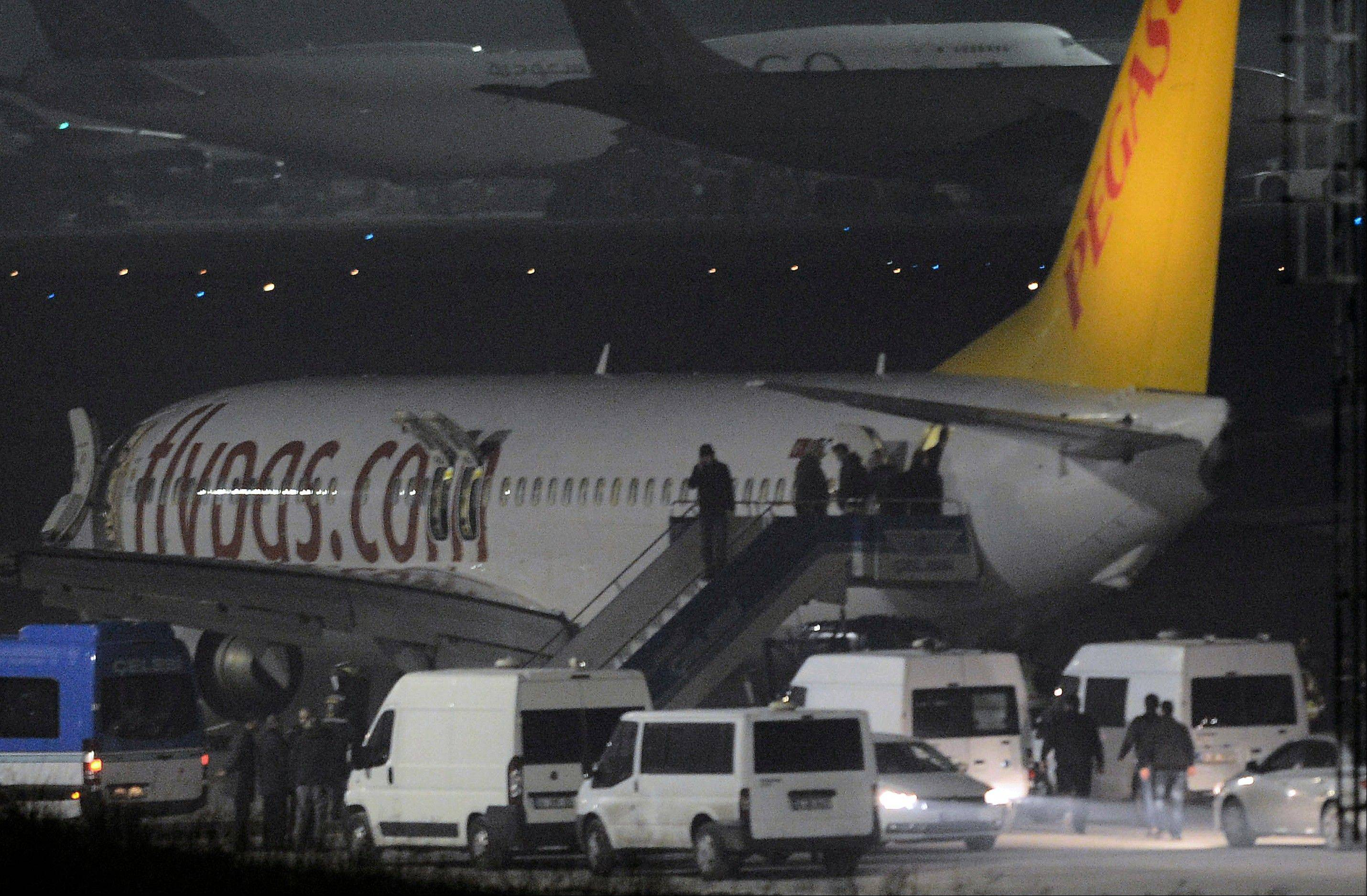 Passengers of private Turkish company Pegasus leave the plane Friday at the Sabiha Gokcen Airport in Istanbul, Turkey.