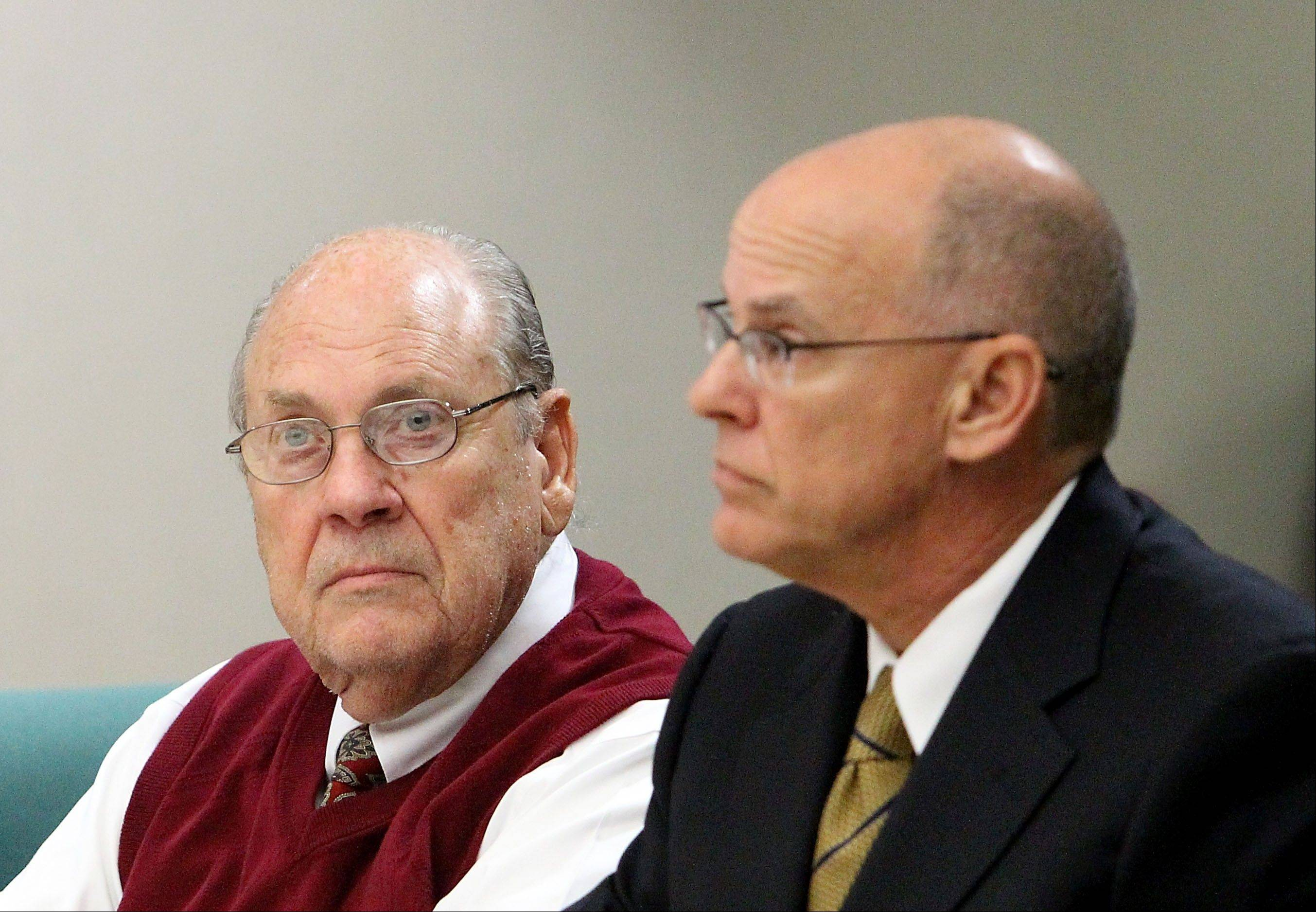 Former Tampa Police captain Curtis Reeves, Jr., left, sits beside his defense attorney Richard Escobar during his bond reduction hearing at the Robert D. Sumner Judicial Center in Dade City, Fla., Wednesday, Feb. 5, 2014. Reeves is accused of fatally shooting Chad Oulson, 43, and wounding his wife, Nicole, 33, during an argument over texting before a movie.