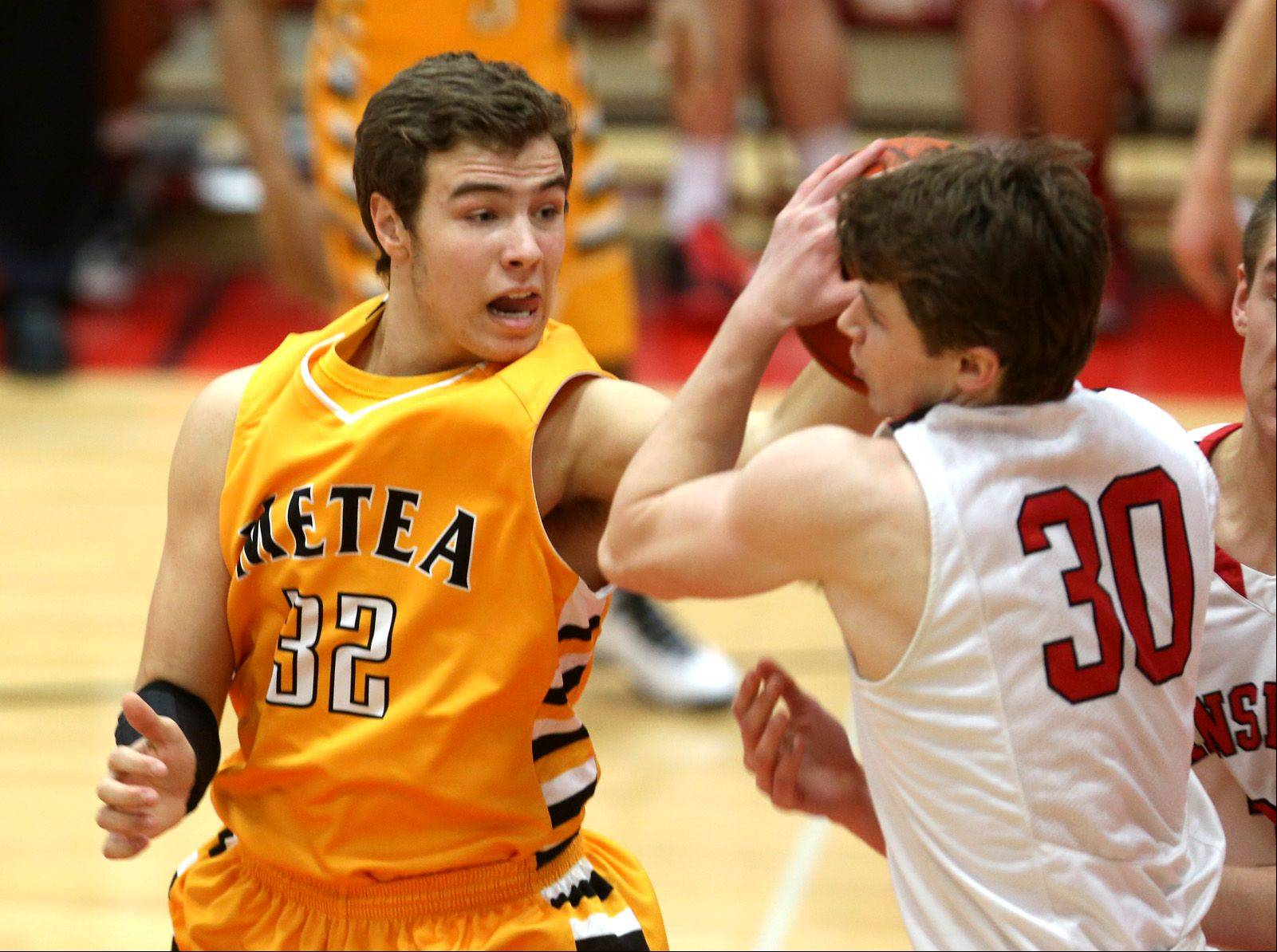 Metea Valley�s Mark Konkle (32), defends Hinsdale Central�s Chase Hamilton (30), right, during a 56-40 loss to the Red Devils in Hinsdale, Friday.