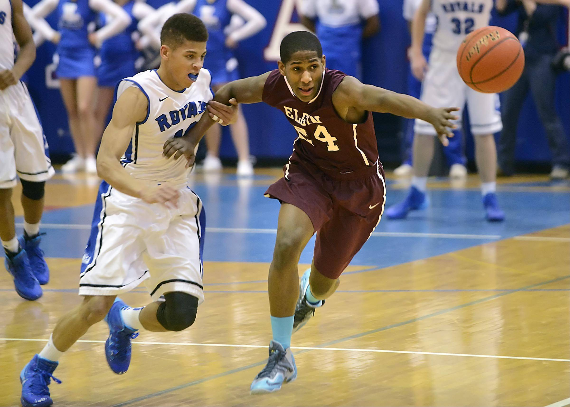 Elgin�s Lavion Baldwin holds off Larkin�s Kendale McCullum as they charge for a loose ball Friday at Larkin.
