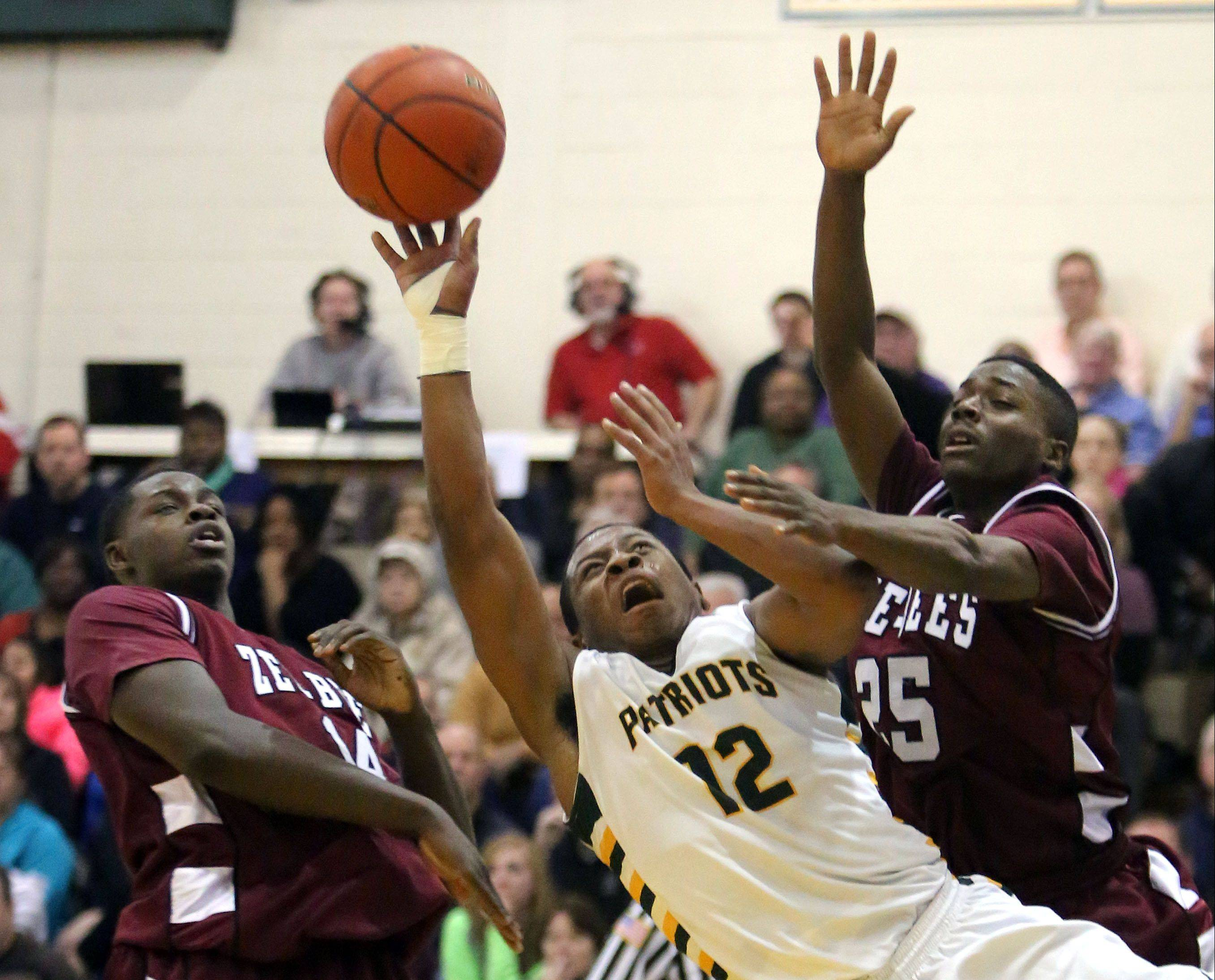Stevenson�s Matt Johnson splits Zion-Benton�s Milik Yarbrough, left, and Fred Calvert during NSC Lake play Friday night at Stevenson.