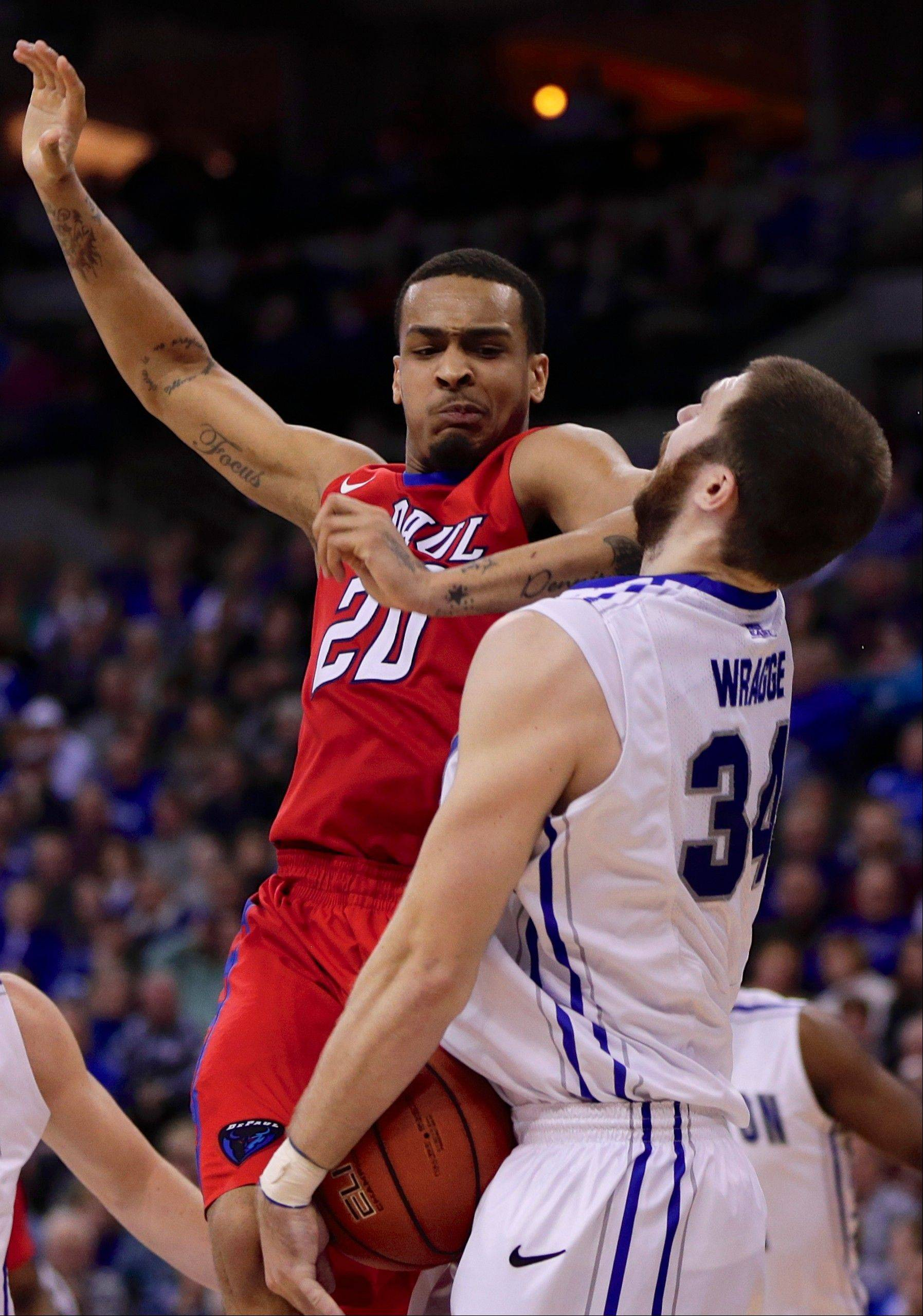 Creighton's Ethan Wragge (34) is hit by the elbow of DePaul's Brandon Young (20) in the second half of an NCAA college basketball game in Omaha, Neb., Friday, Feb. 7, 2014. Creighton won 78-66. (AP Photo/Nati Harnik)