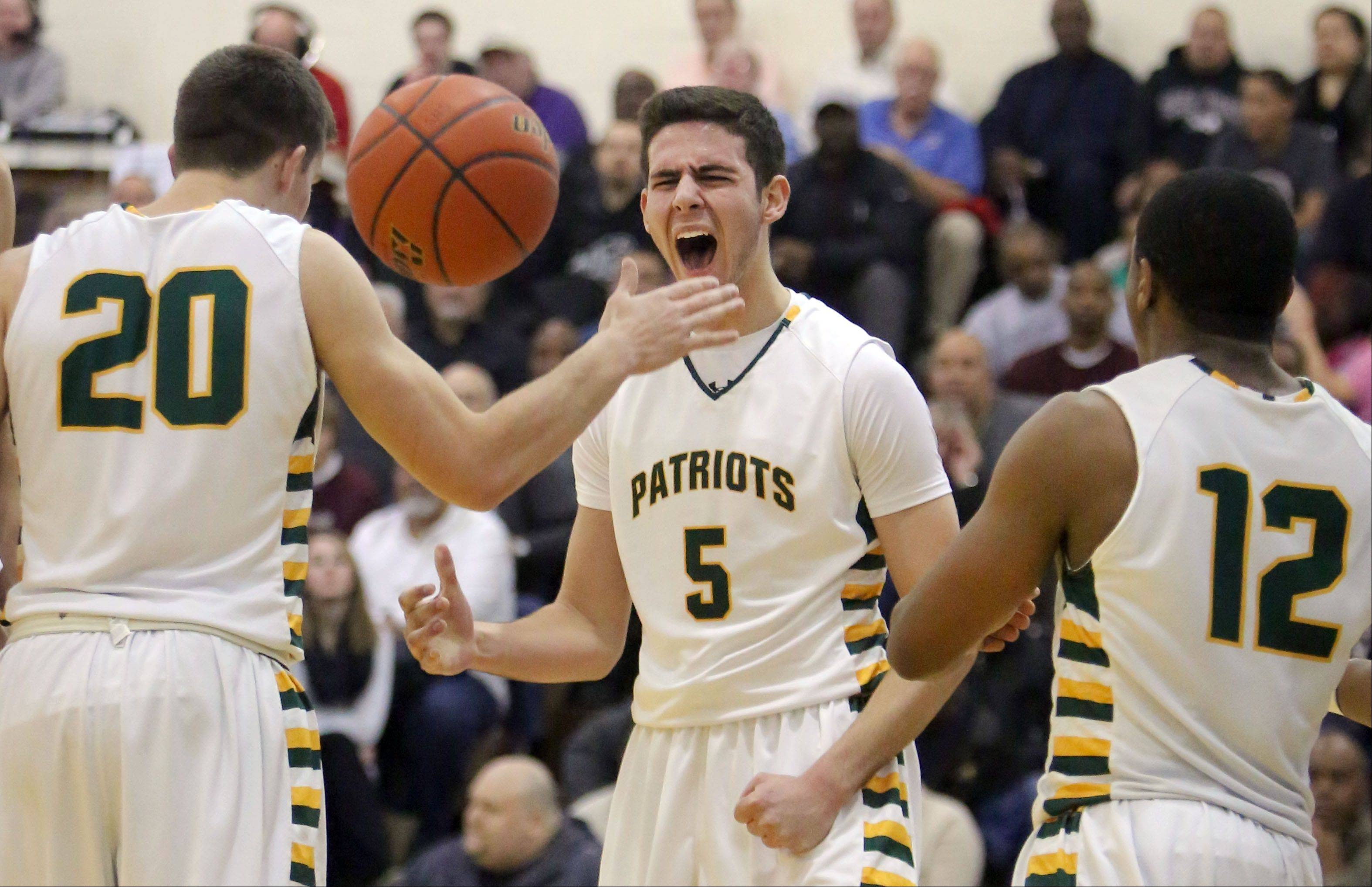 Stevenson�s Sam Panitch celebrates with Matt Morrissey, left, and Matt Johnson.