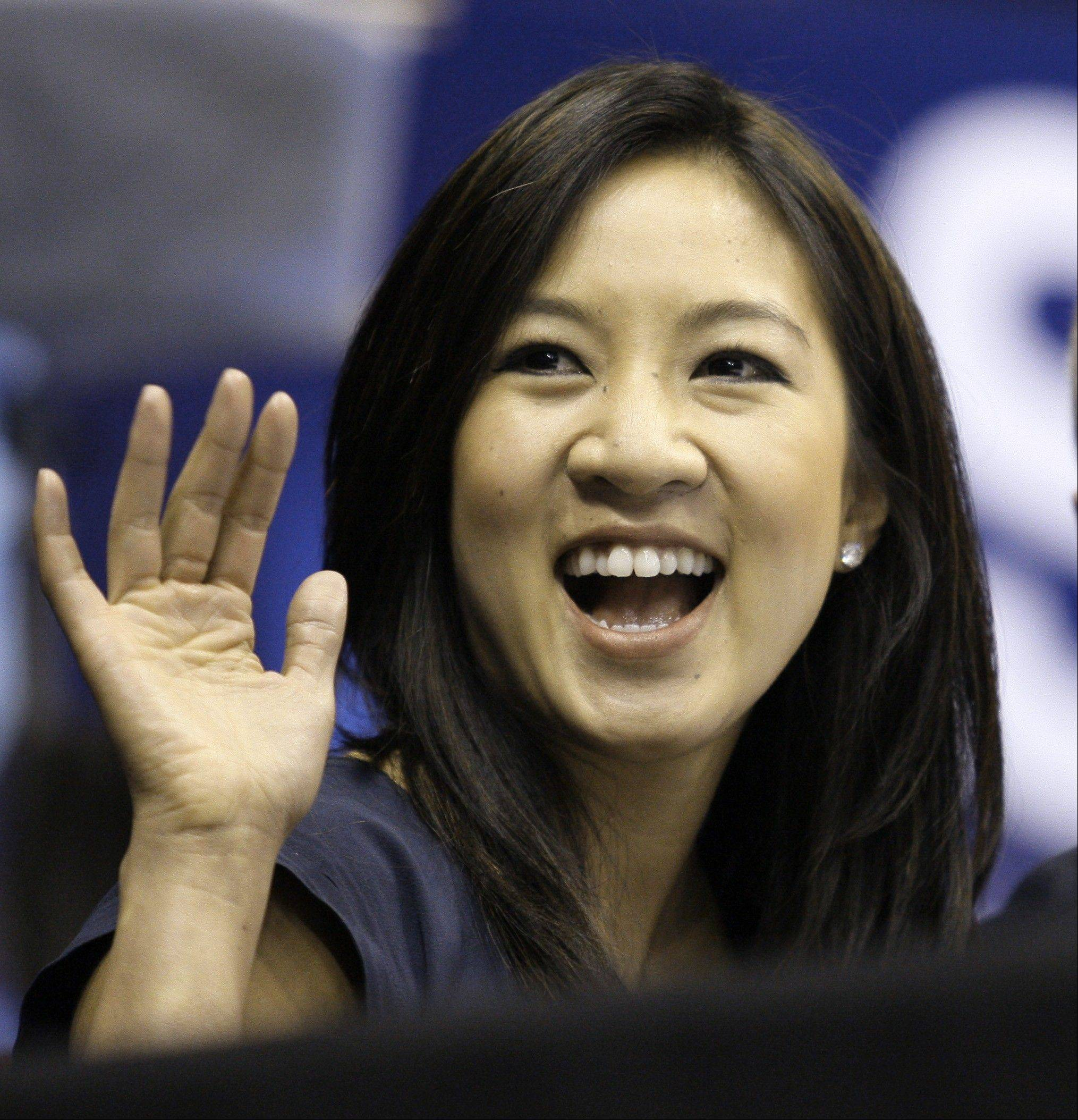Michelle Kwan is fitting in some time for political campaigning while she covers the Sochi Game by asking notable names to pose for a photo holding a pin supporting her husband for governor of Rhode Island. Clay Pell, a Democrat, announced his candidacy Jan. 27.