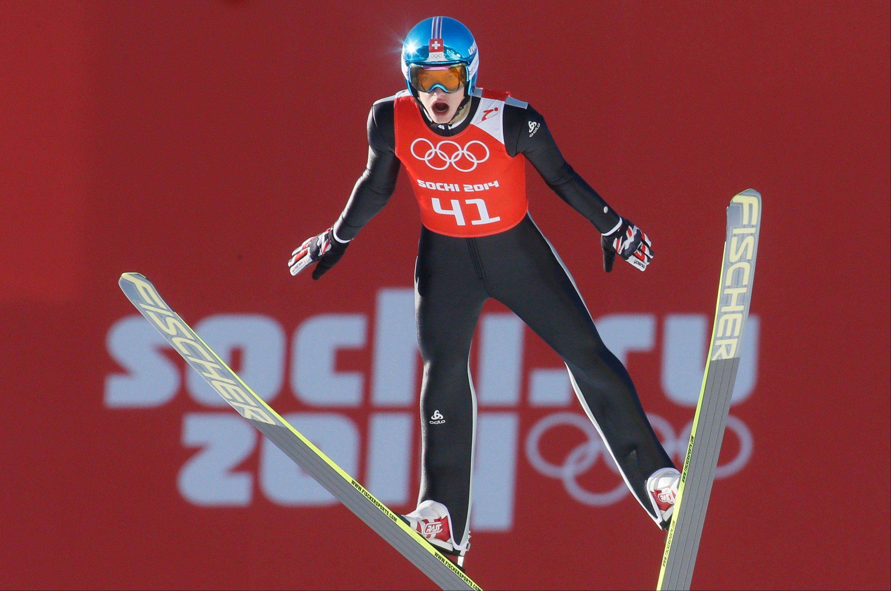 Switzerland�s Gregor Deschwanden makes an attempt Friday during the men�s normal hill ski jumping training at the 2014 Winter Olympics in Krasnaya Polyana, Russia.