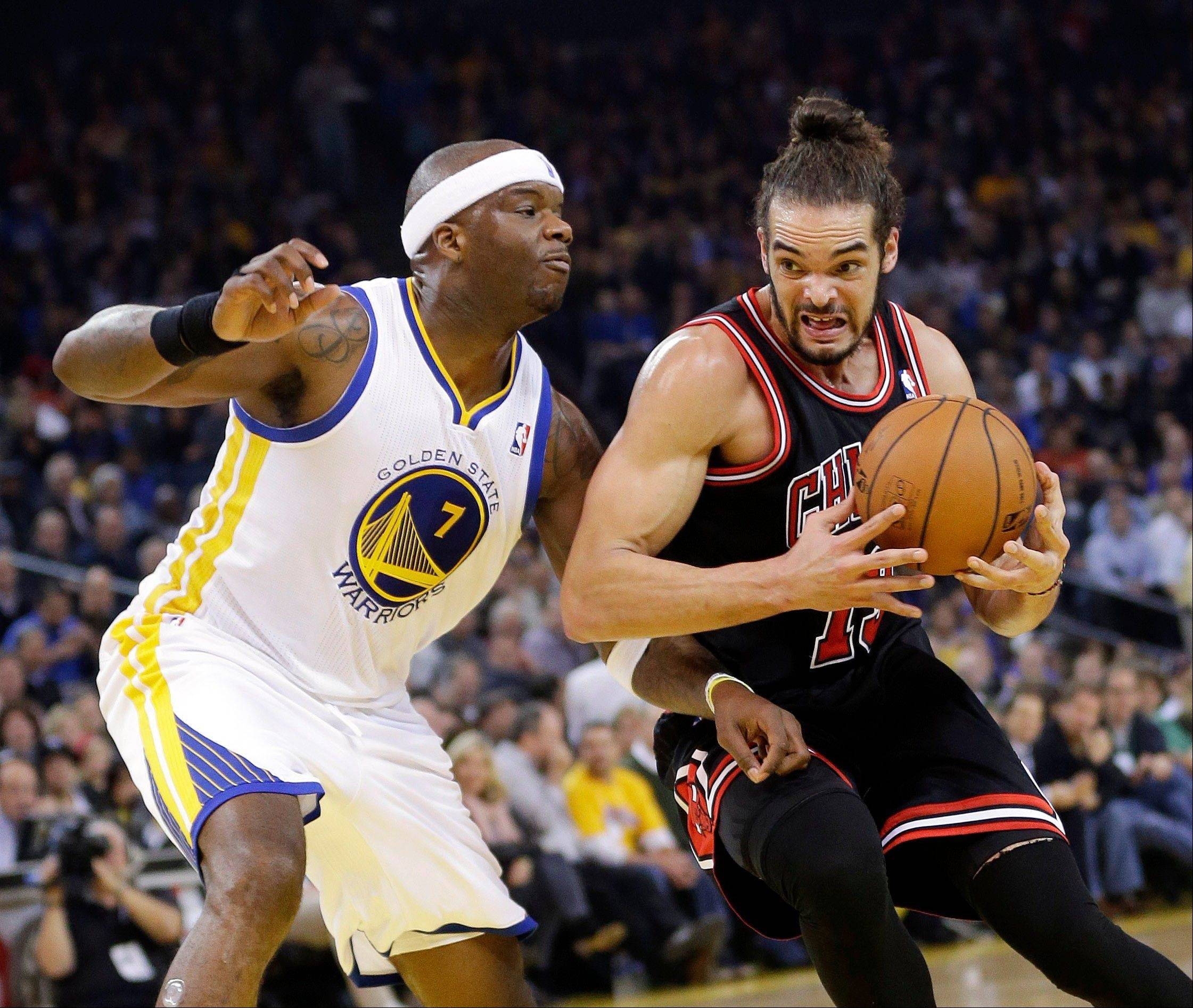 Associated Press The Bulls� Joakim Noah dribbles next to Golden State Warriors� Jermaine O�Neal during the first half of the game Thursday in Oakland, Calif.