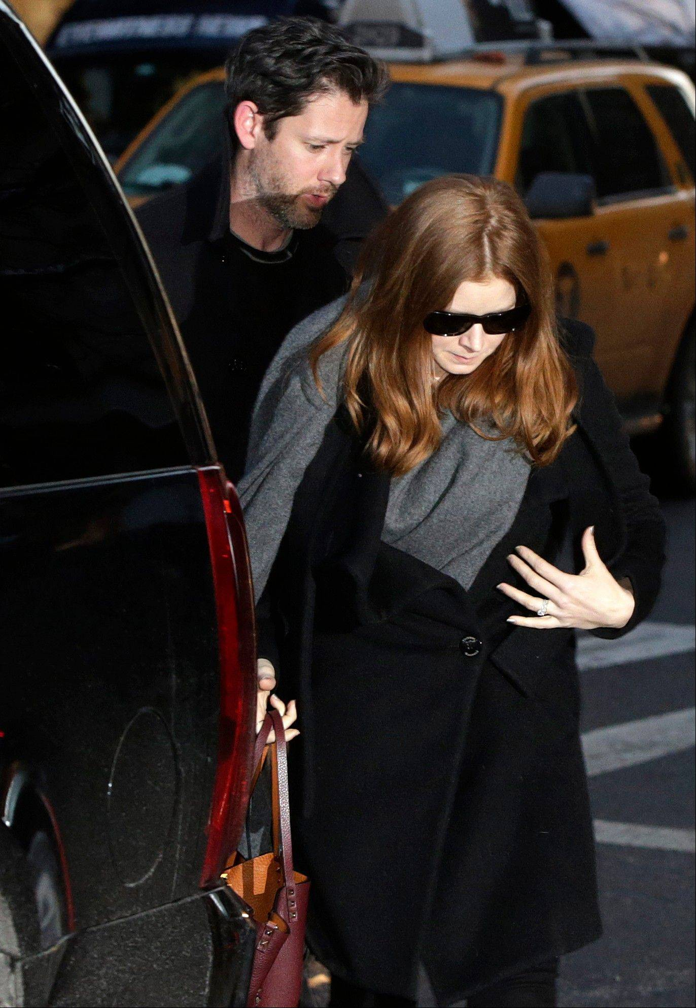 Oscar-nominated actress Amy Adams and her fiance Darren Le Gallo arrive at a wake for actor Philip Seymour Hoffman at the Frank E. Campbell Funeral Home on Manhattan's Upper East Side, Thursday, Feb. 6, 2014, in New York. Hoffman died Sunday of a suspected drug overdose in his New York apartment.