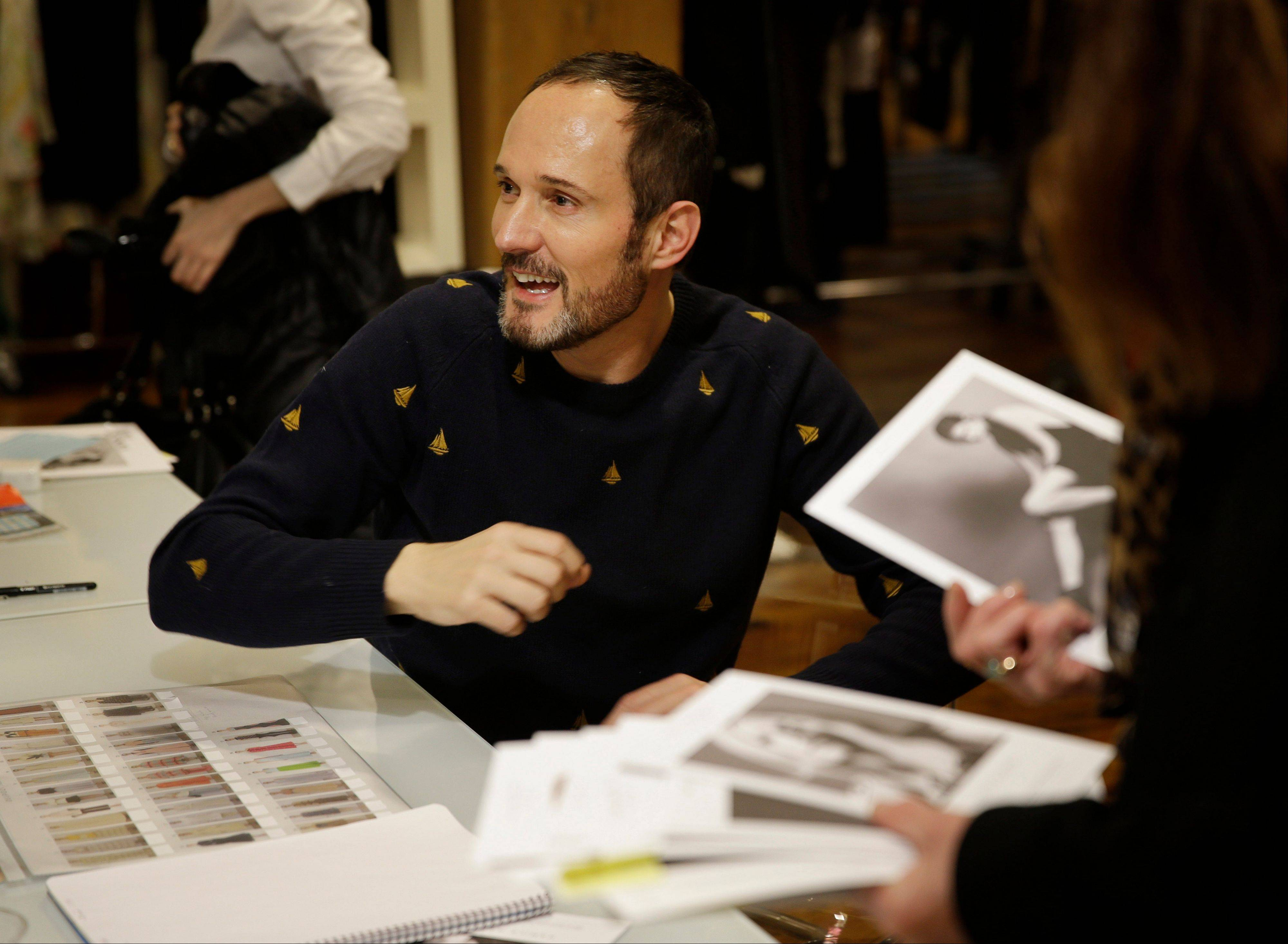 Josep Font, creative director of DelPozo, works with his team during a model casting in New York. He takes pride in his attention to couture-level detail.