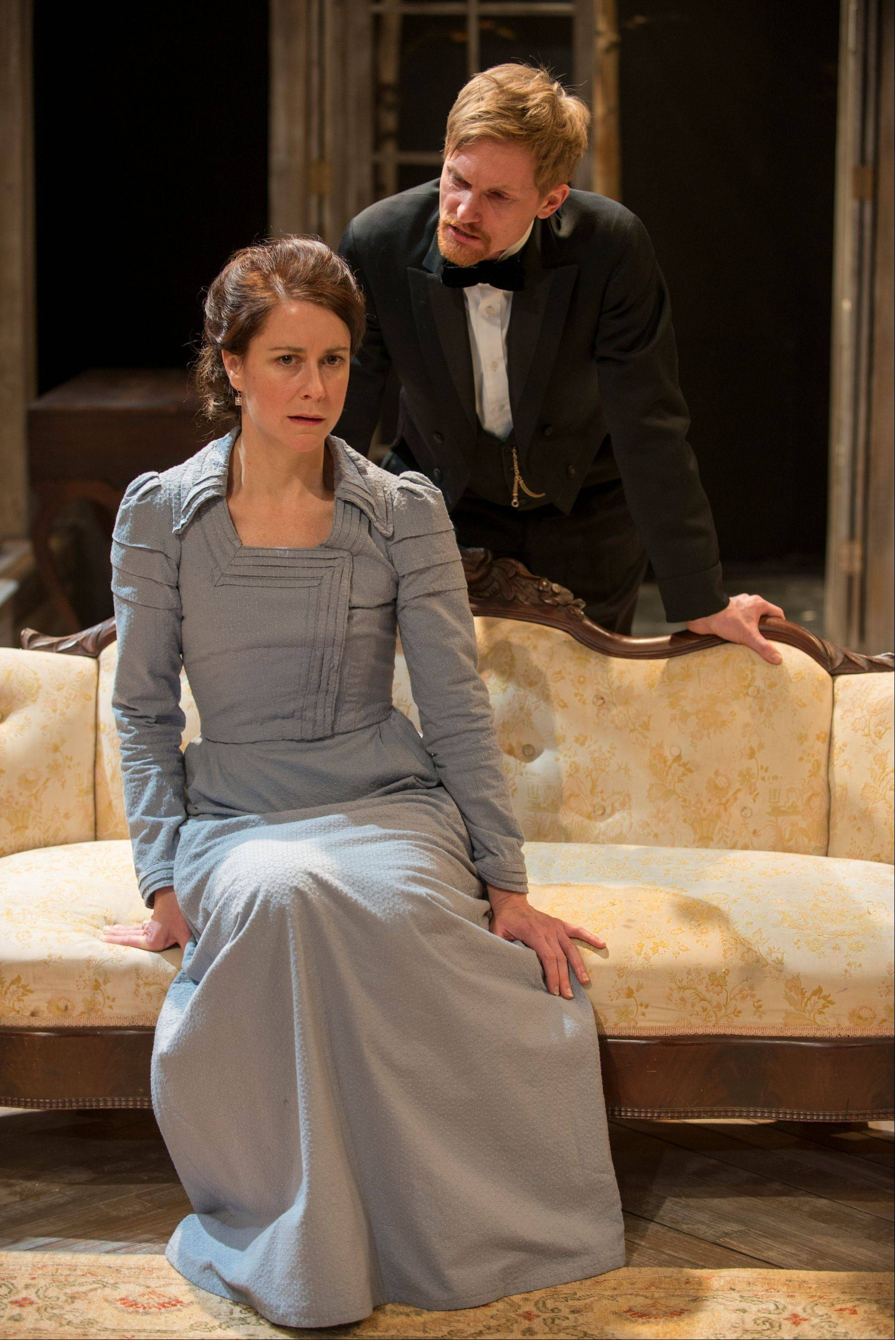 Kate Fry stars as the titular Hedda Gabler, a woman who unhappily trades her freedom for financial security, in the Writers Theatre revival of Henrik Ibsen's classic. Scott Parkinson plays Judge Brack, an old friend.