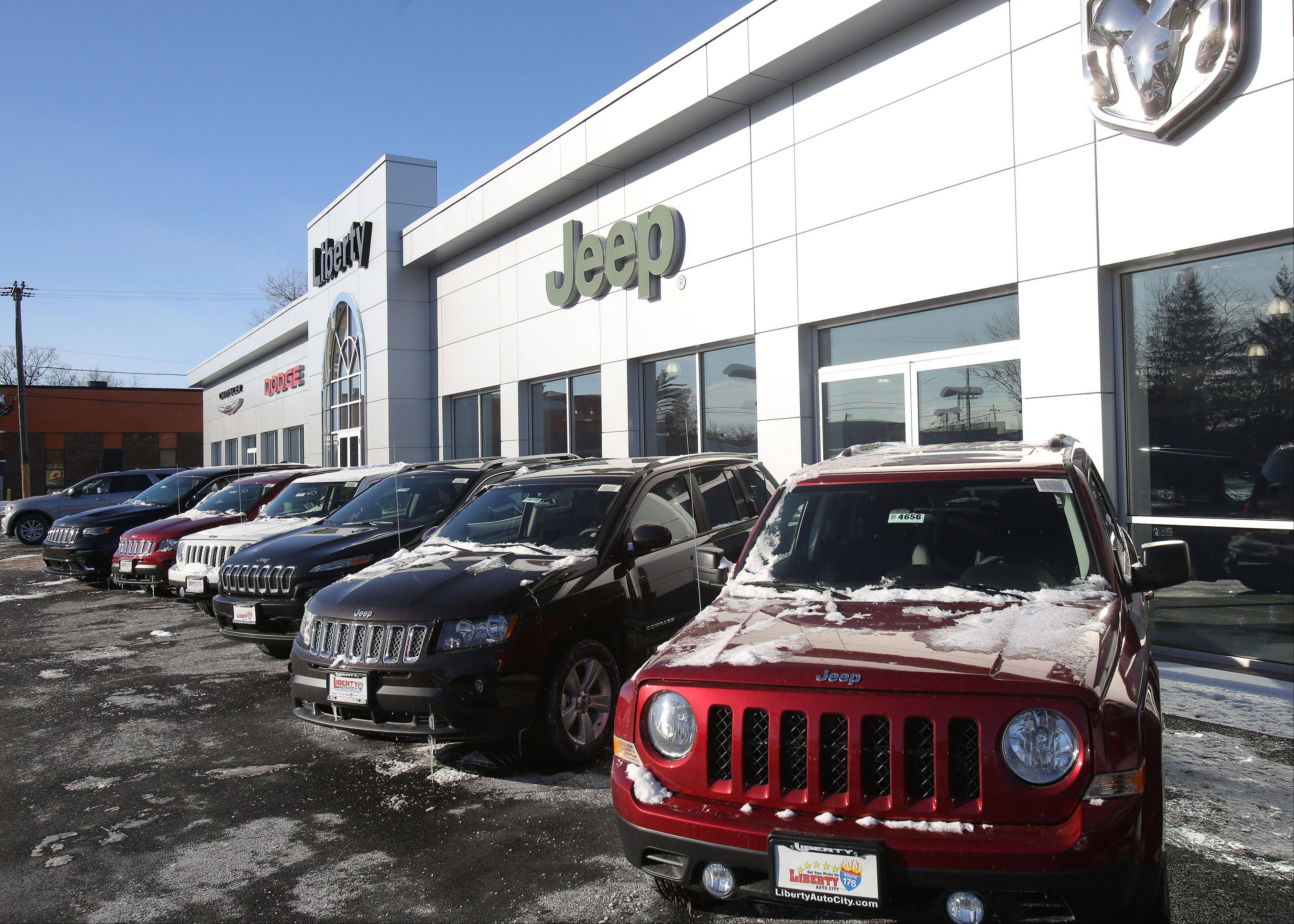New Jeep Cherokees and Patriots await customers at Liberty Auto City in Libertyville.