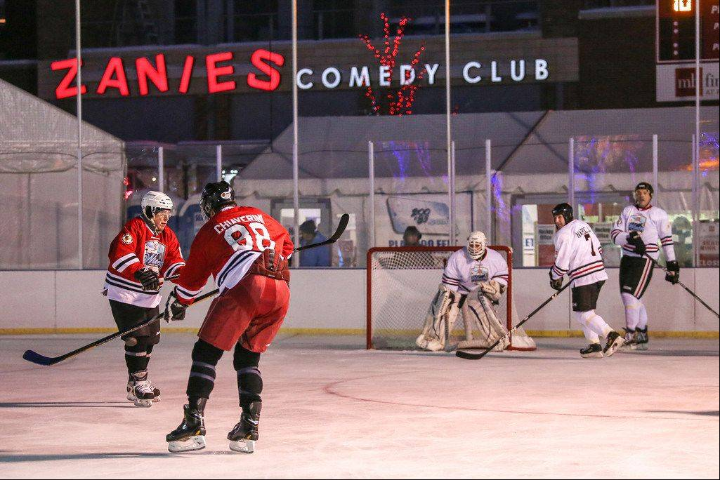 COURTESY OF EDWARD MARSHALLChicago Blackhawks alumni and other celebrities faced off Friday night in an outdoor hockey game in Rosemont's entertainment district.