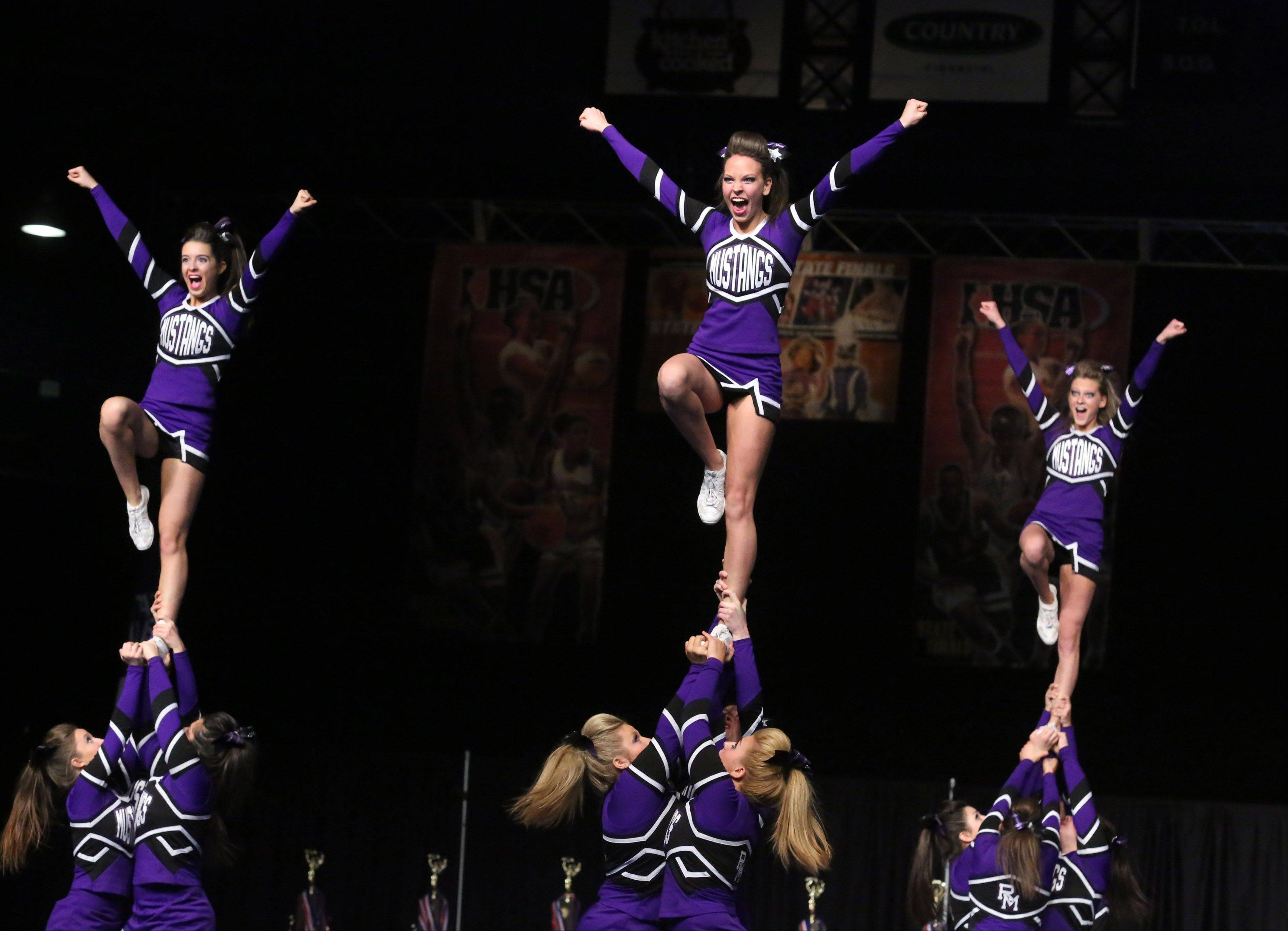 Rolling Meadows High School's cheer team performs in the large team category.