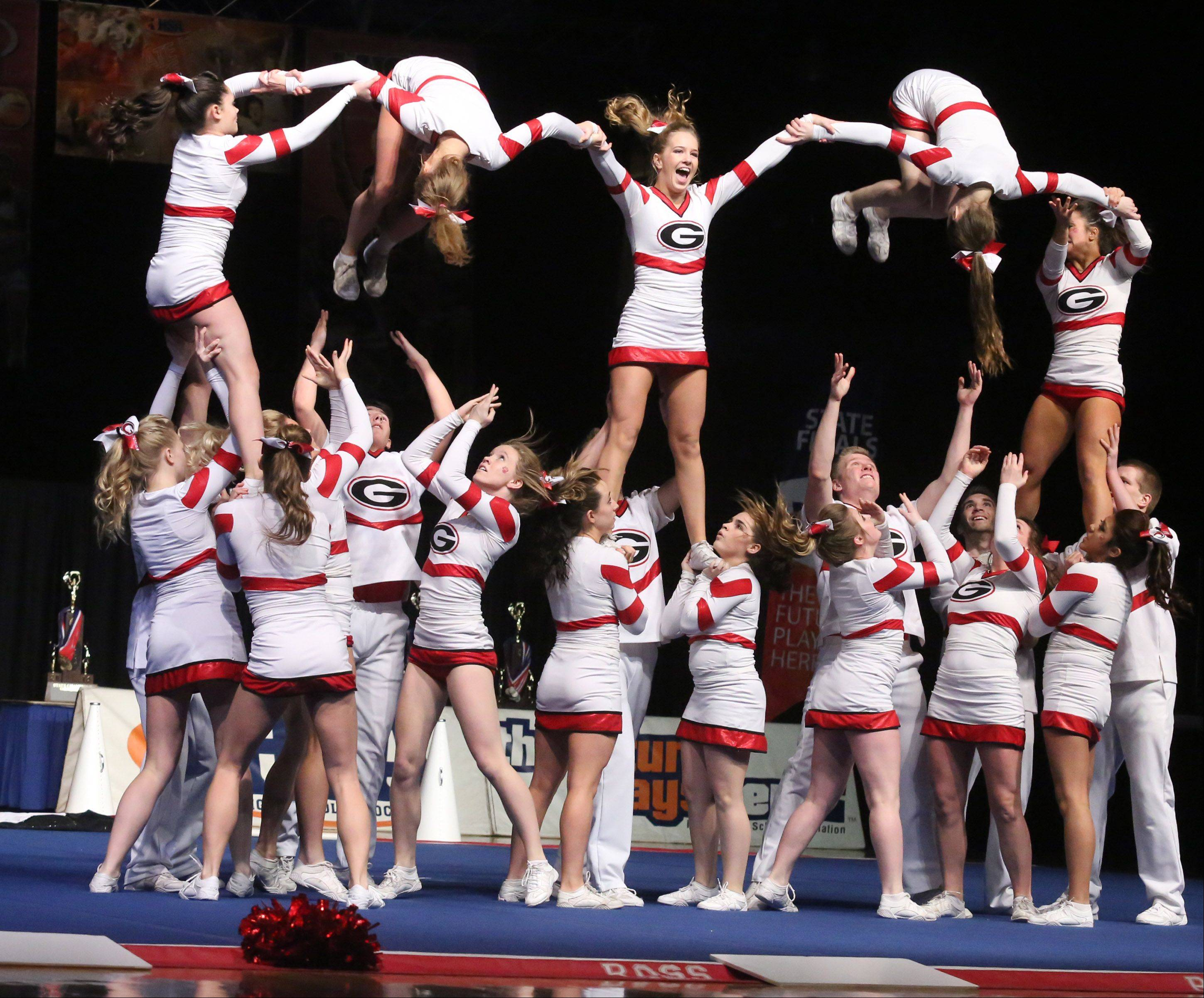 Grant High School's cheer team performs in the coed team category.