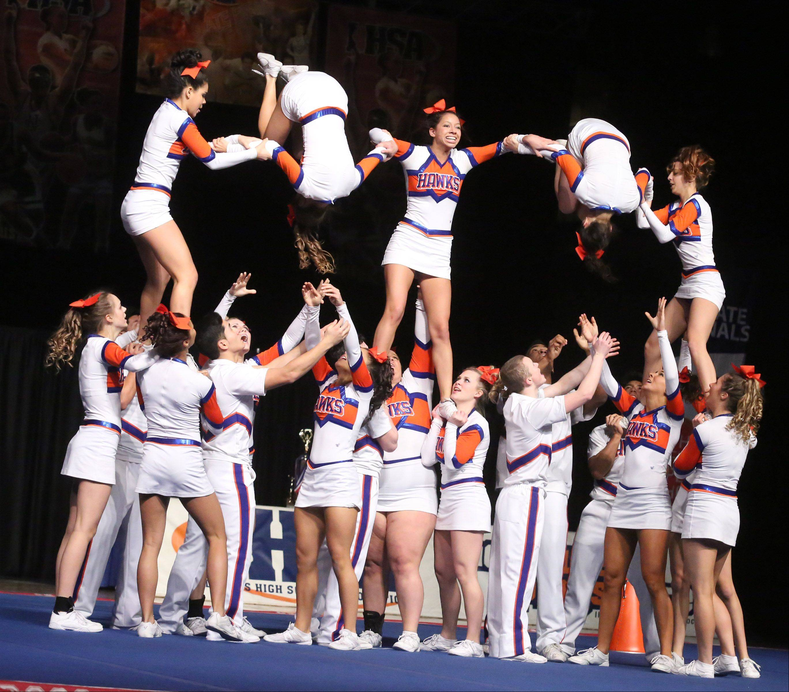 Hoffman Estates High School's cheer team performs in the coed team category.
