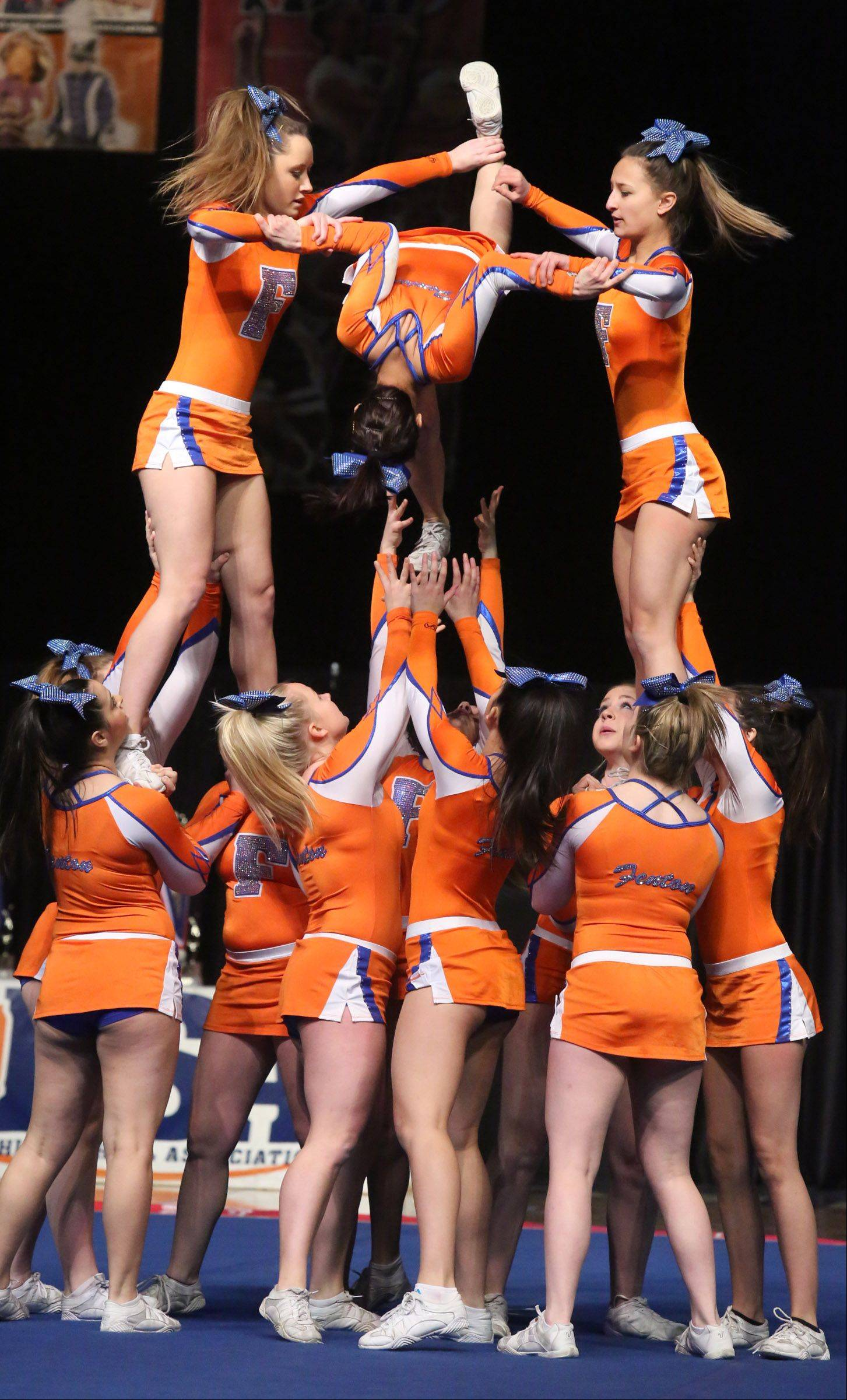 Fenton High School's cheer team performs in the medium team category.