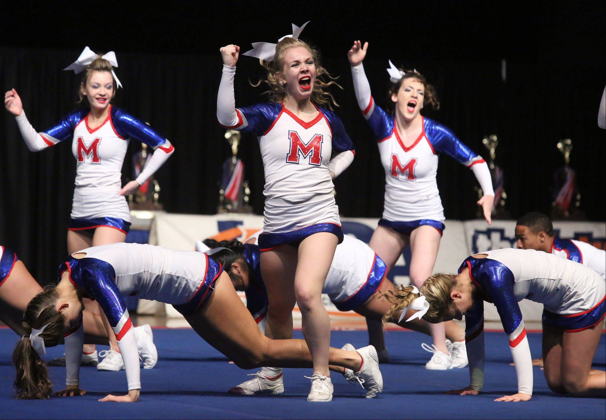 Rosary High School's cheer team performs in the medium team category.
