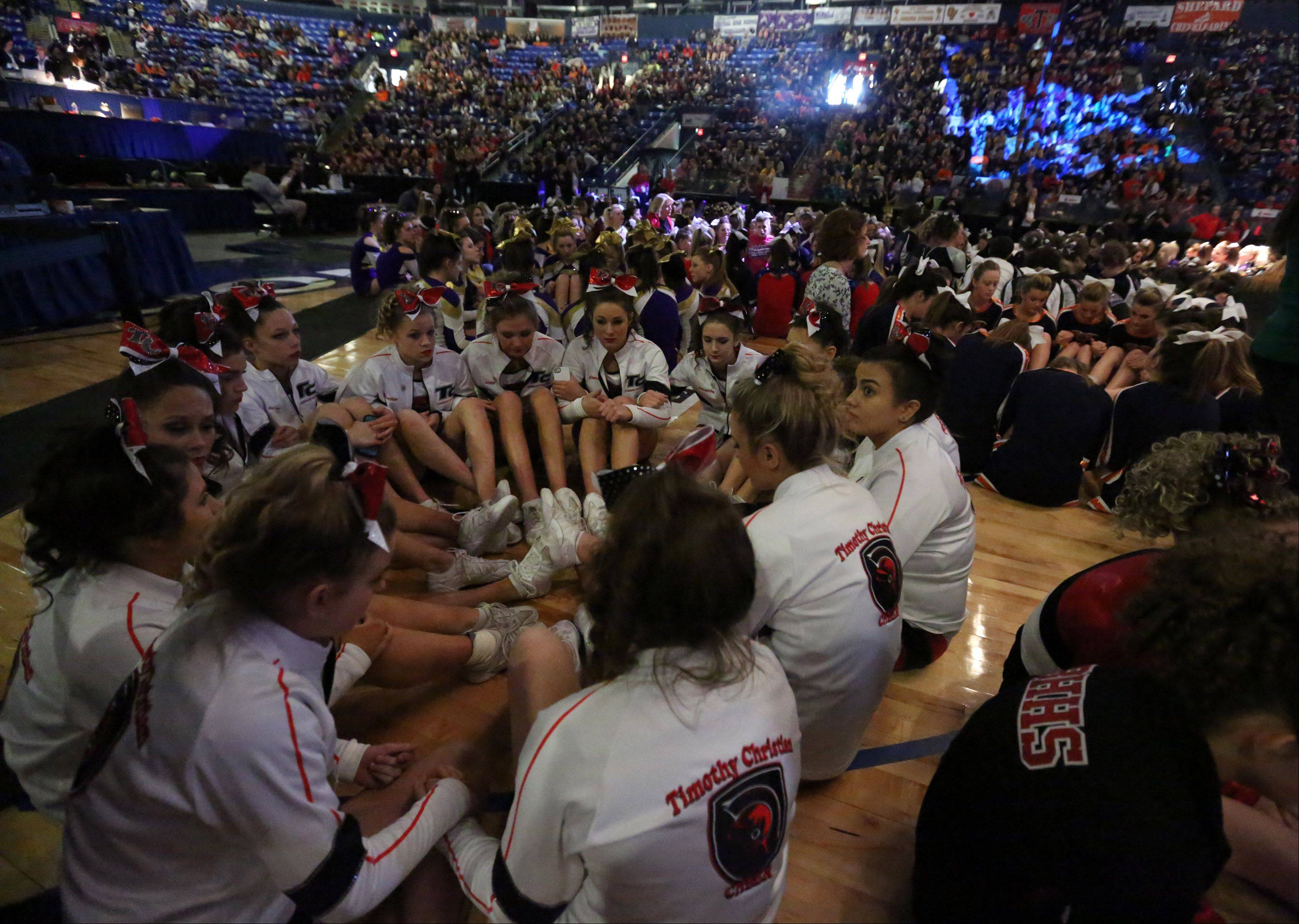 Timothy Christian High School's cheer team and other teams wait for results to be announced in preliminary rounds of IHSA state finals on Friday in Bloomington.