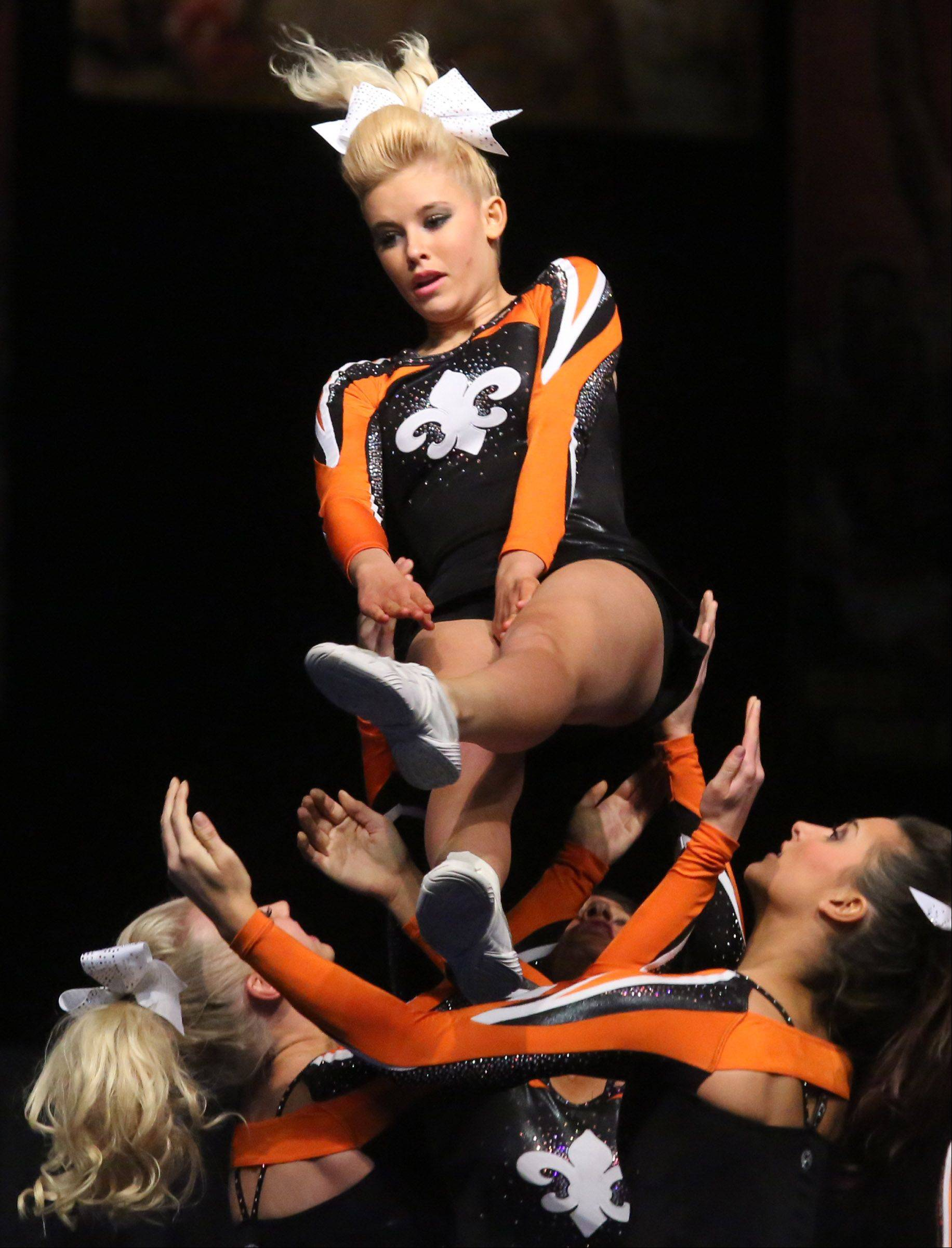St. Charles East High School's cheer team performs in the large team category.