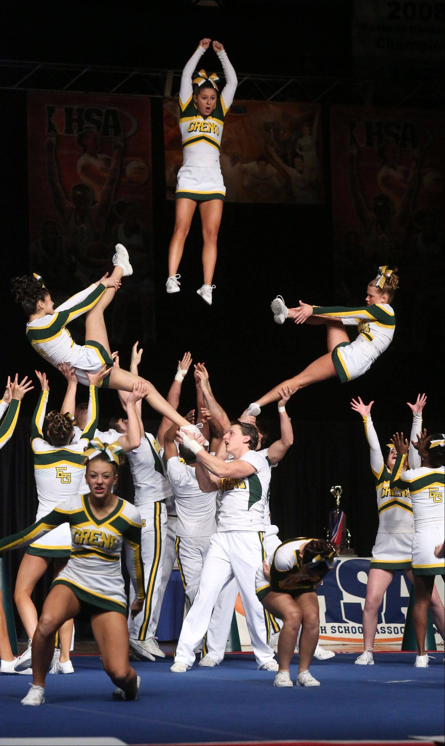 Elk Grove High School's cheer team performs in the coed team category in preliminary rounds of IHSA state championships on Friday in Bloomington.