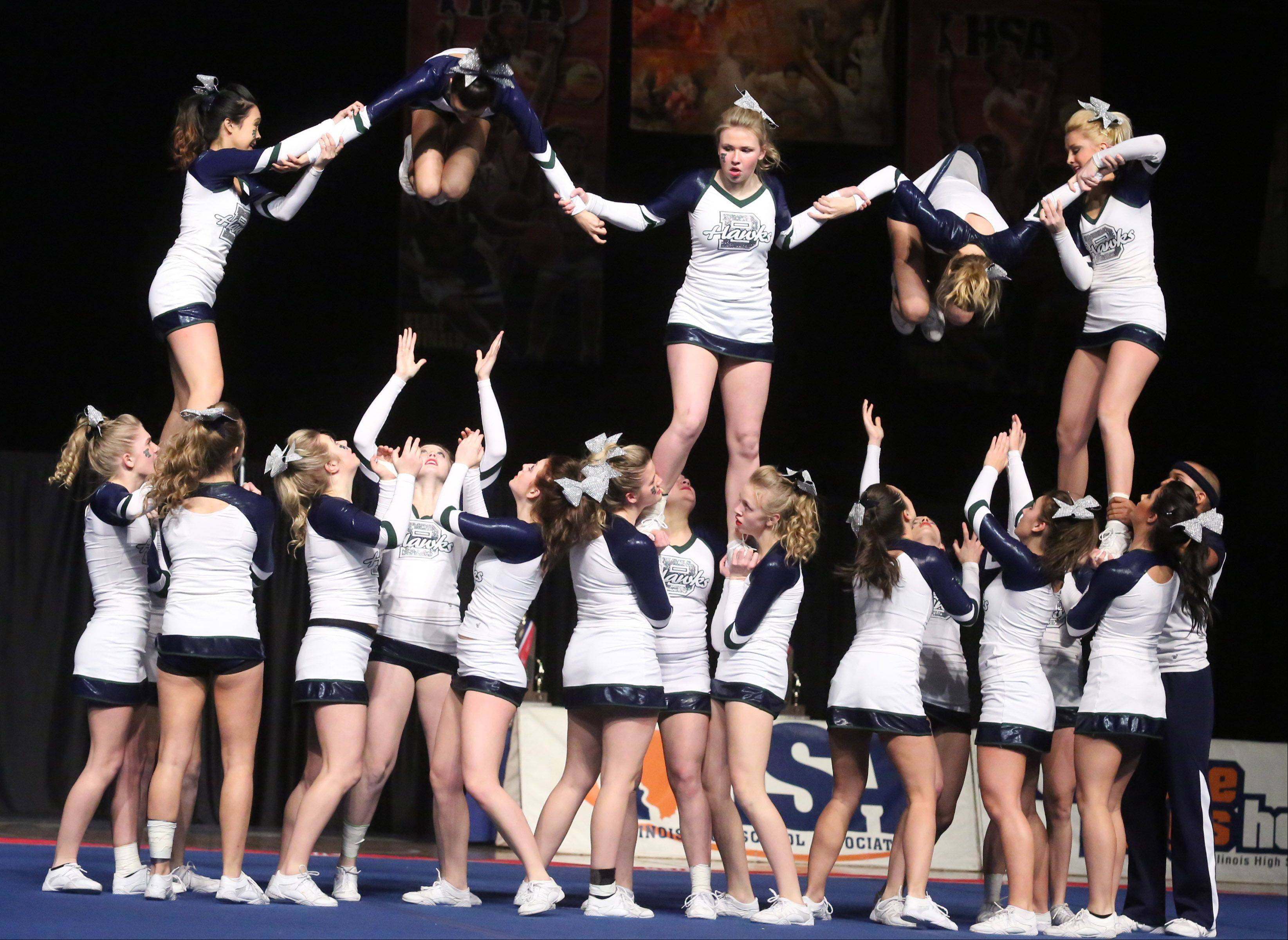 Bartlett High School performs in the large team category in preliminary rounds of IHSA cheerleading state tournament on Friday in Bloomington.