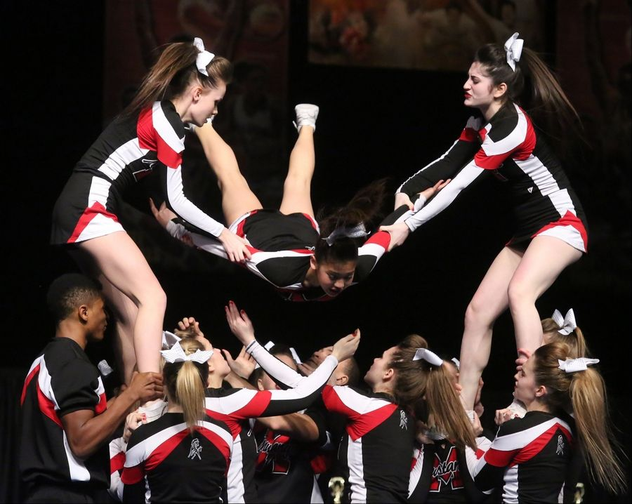 Mundelein High School performs in the coed team category in preliminary rounds of IHSA state cheerleading championships Friday in Bloomington.