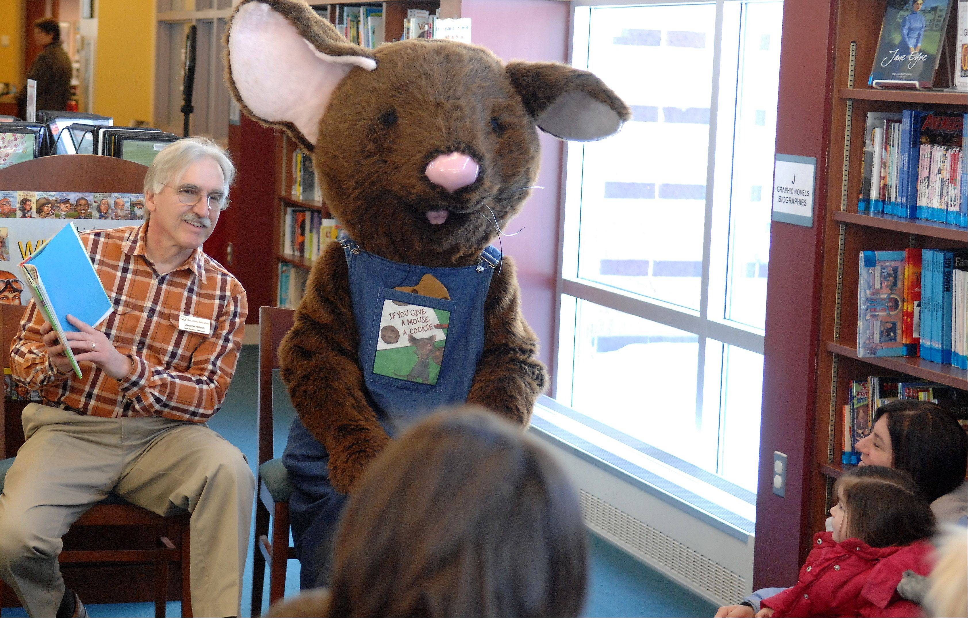 "Town and Country Library youth services director Dwayne Nelson reads ""If You Give a Mouse a Cookie"" with a special appearance by Cookie Mouse shows Friday in Elburn."