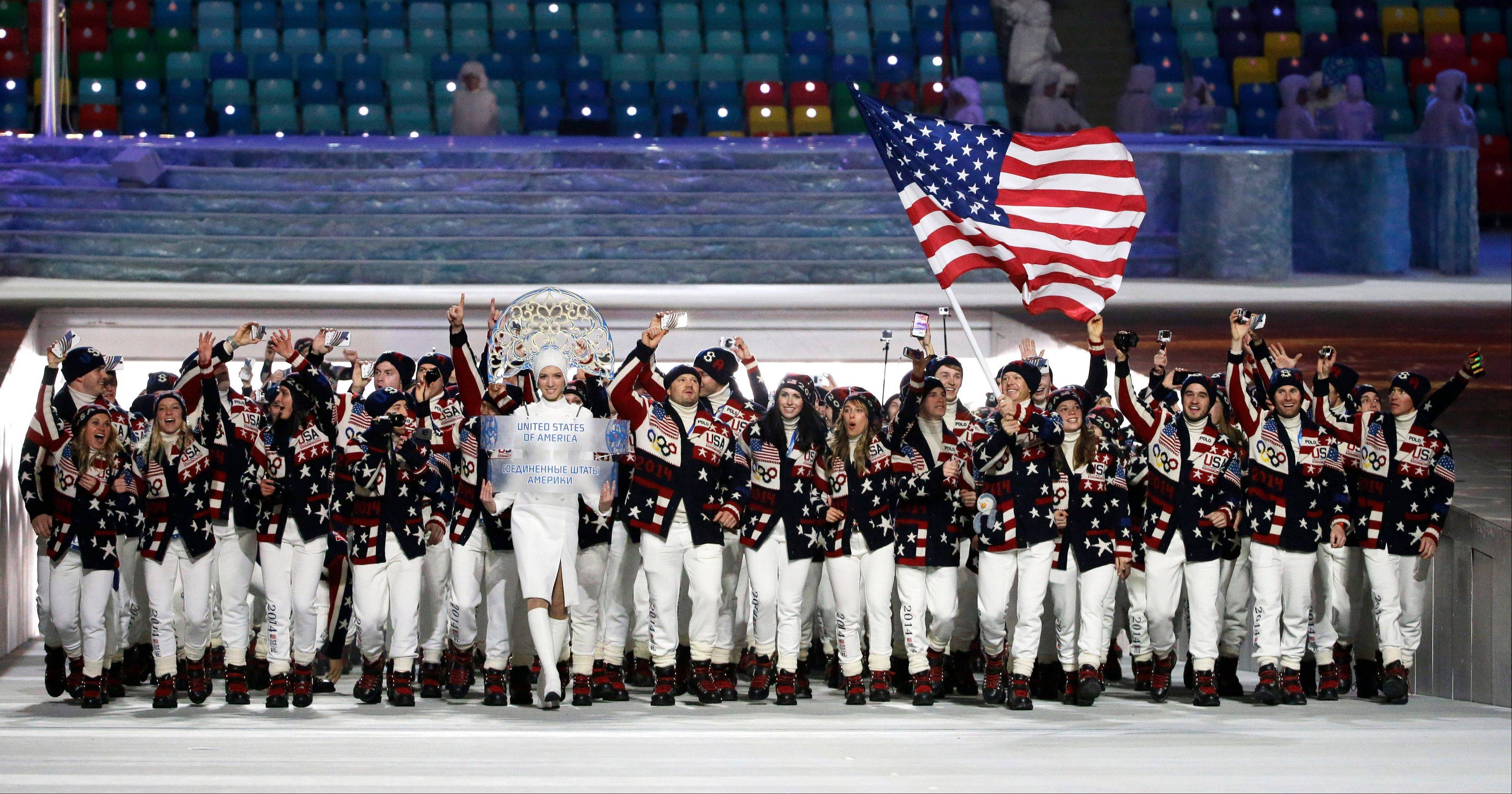 Todd Lodwick of the United States carries the national flag as he leads the team during the opening ceremony.