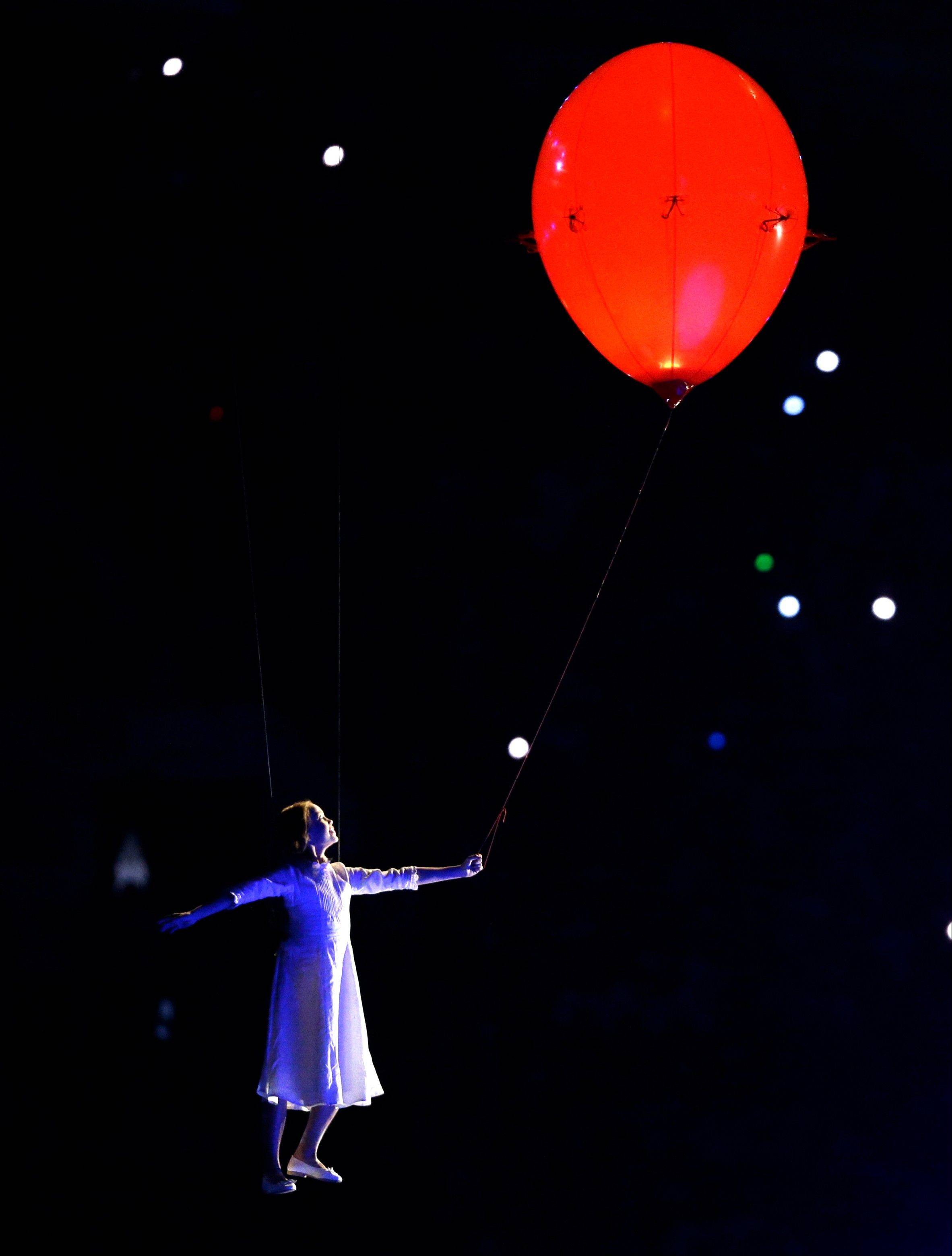 An artist performs during the opening ceremony.