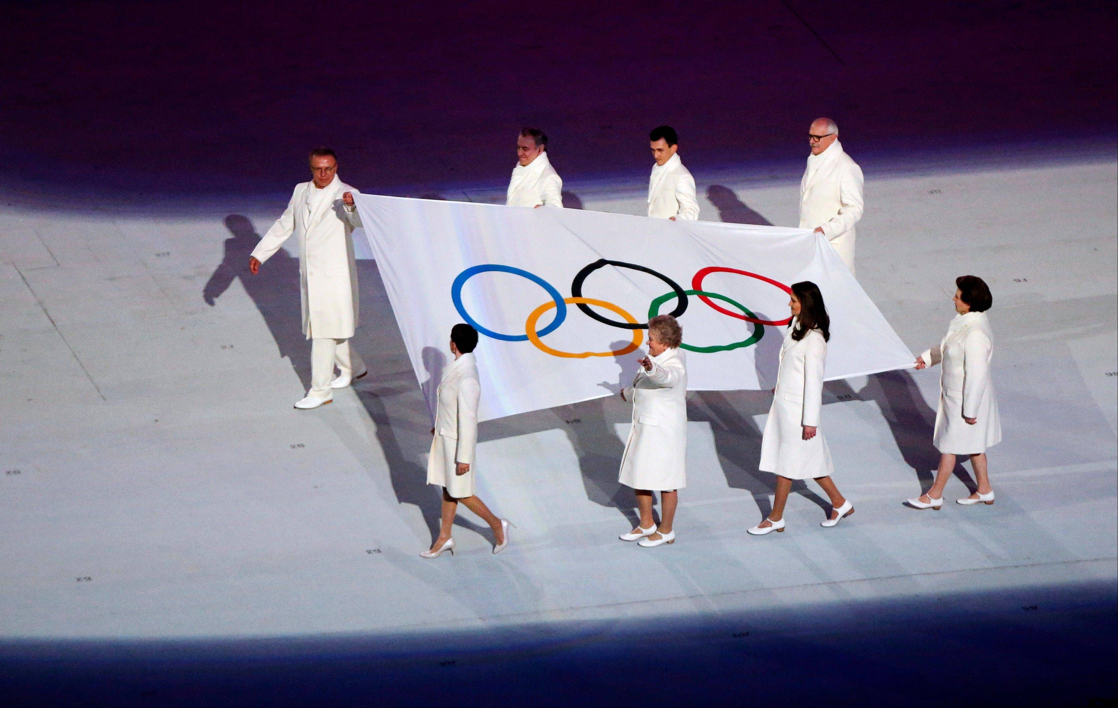The Olympic flag is carried during the opening ceremony.