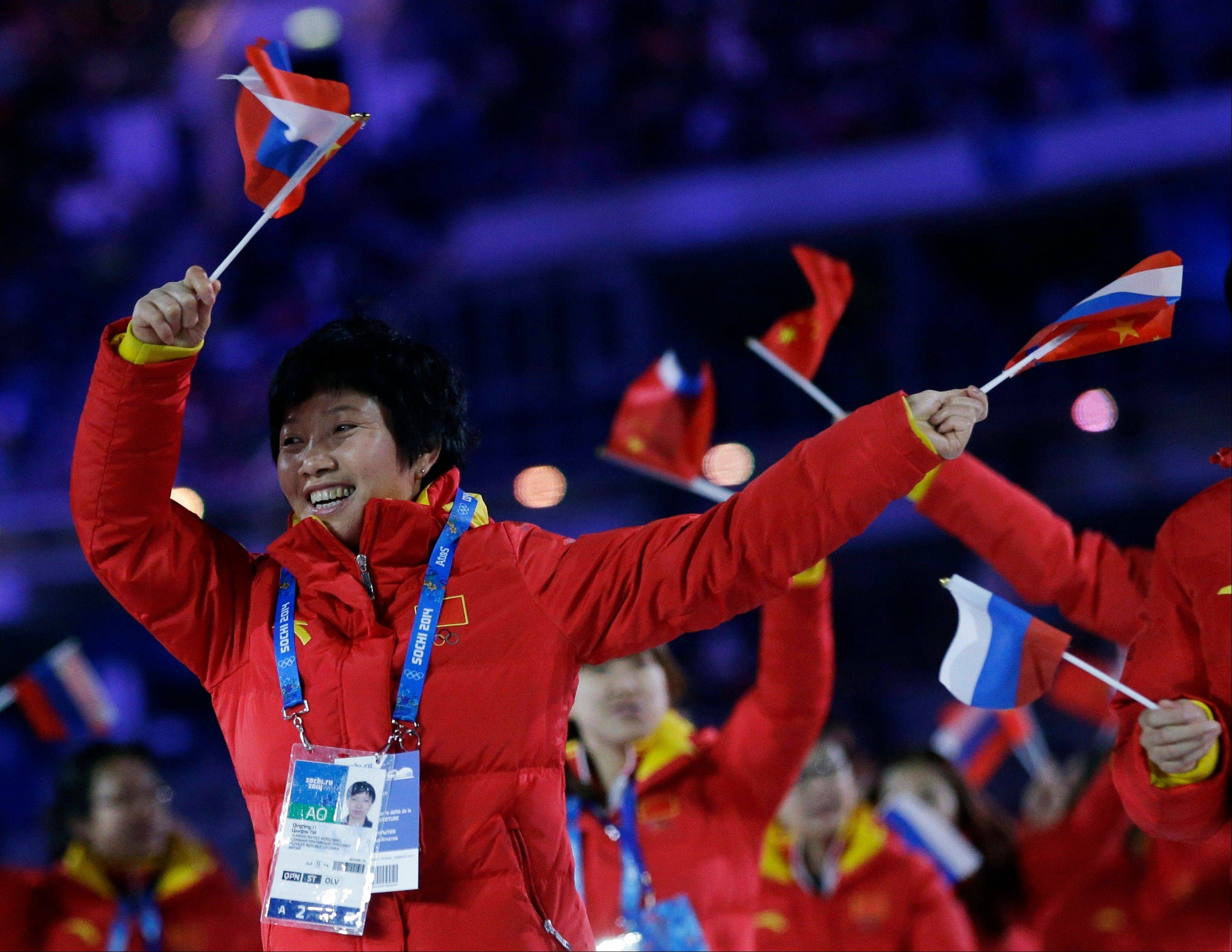 Members of the Chinese team cheer during the opening ceremony.