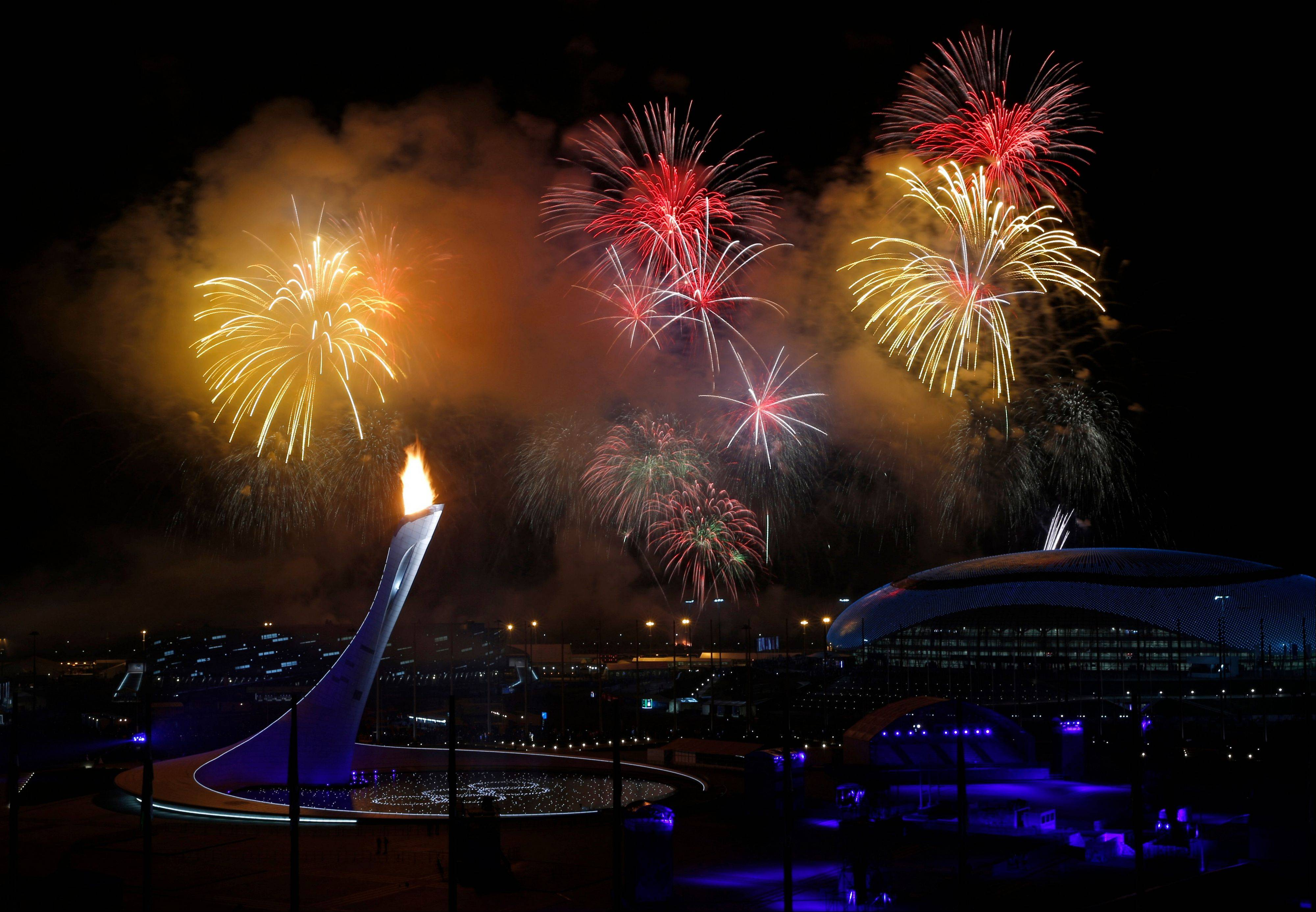 Fireworks are seen over the Olympic Cauldron during the opening ceremony .